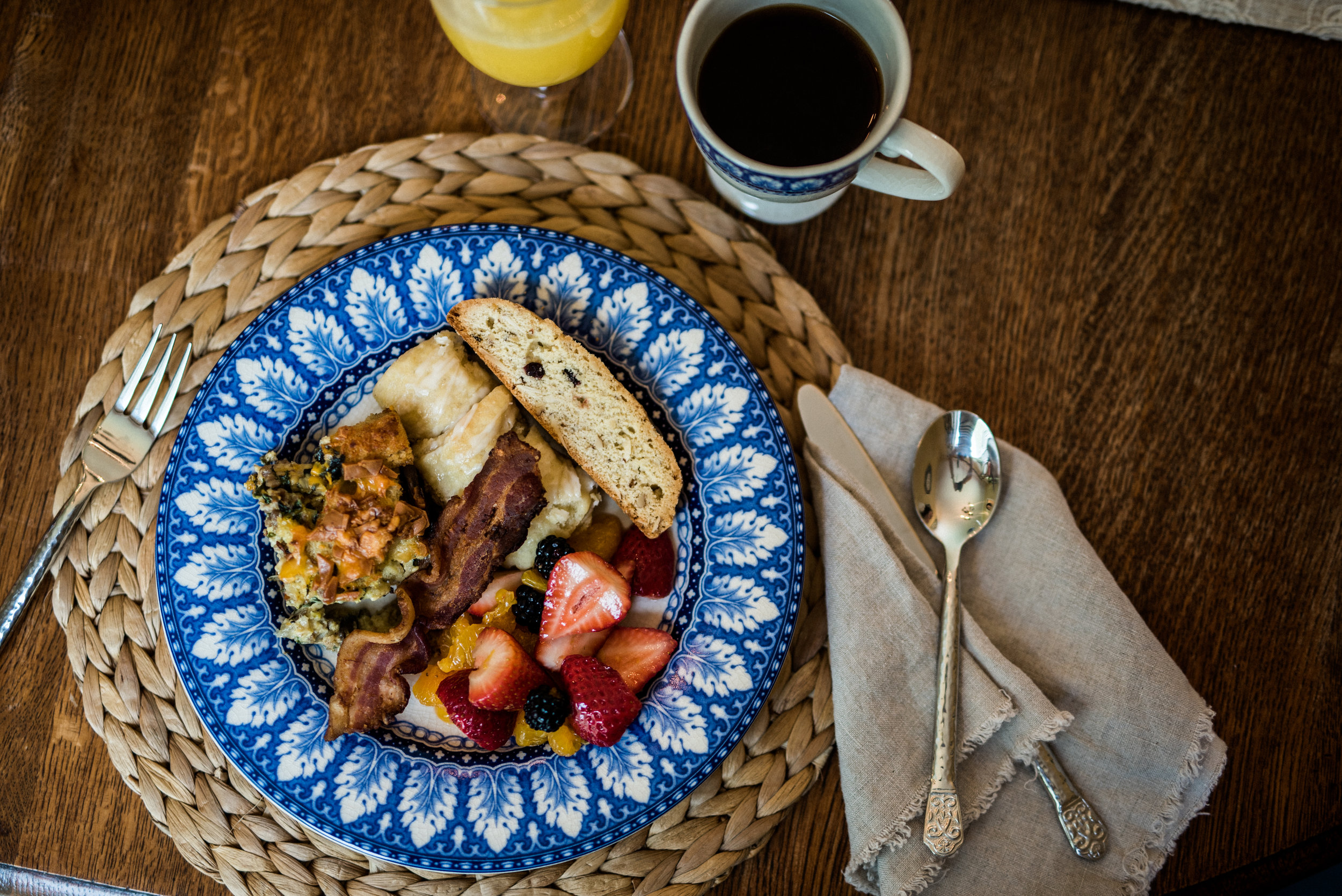 Birthday brunch with friends. Sausage swiss chard egg casserole, bacon, fresh fruit & Yeast walnuts rolls and biscotti. The best part is that everyone brought a dish to share! Photo by Rachel Cuthbert Photography