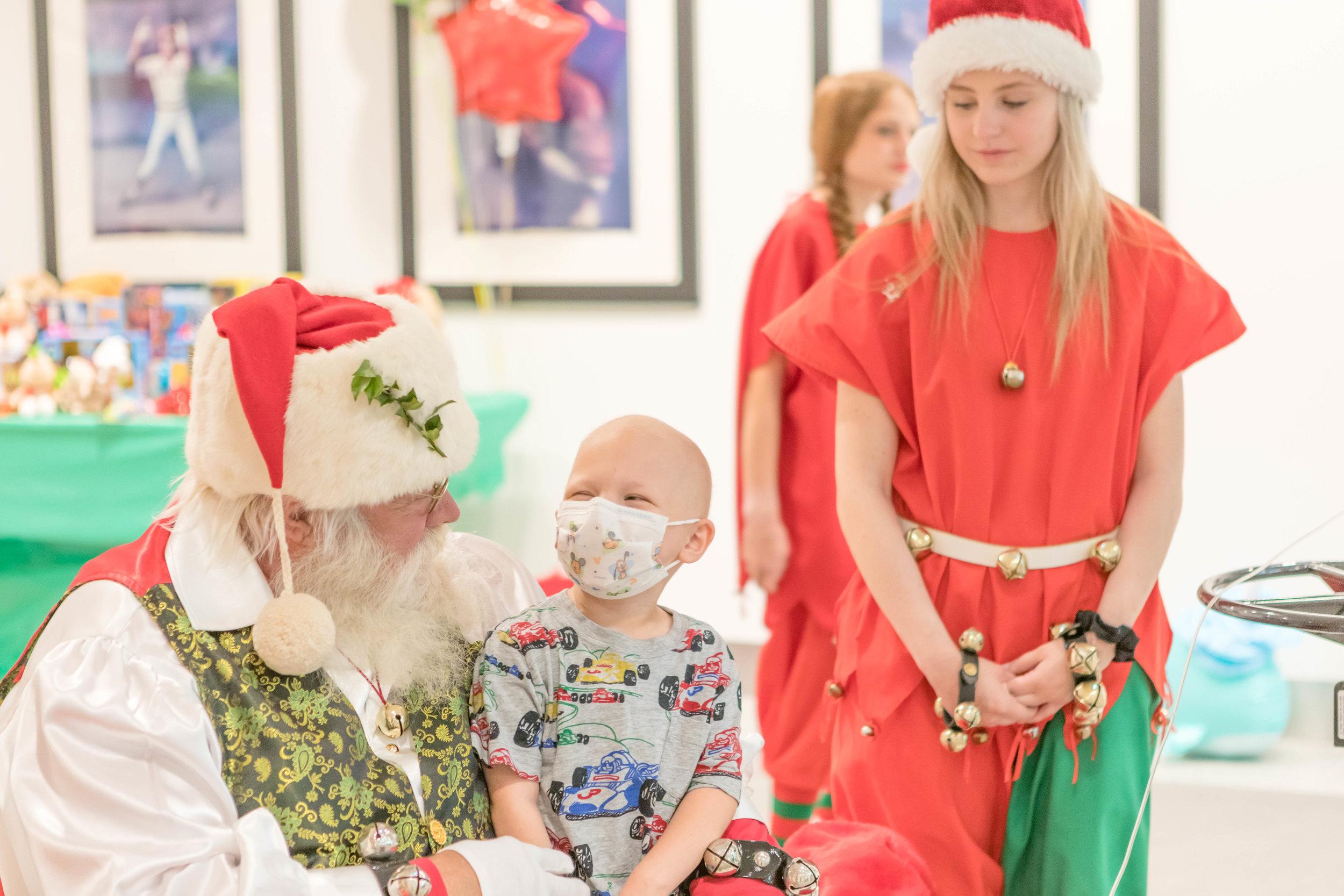 Santa visiting with children