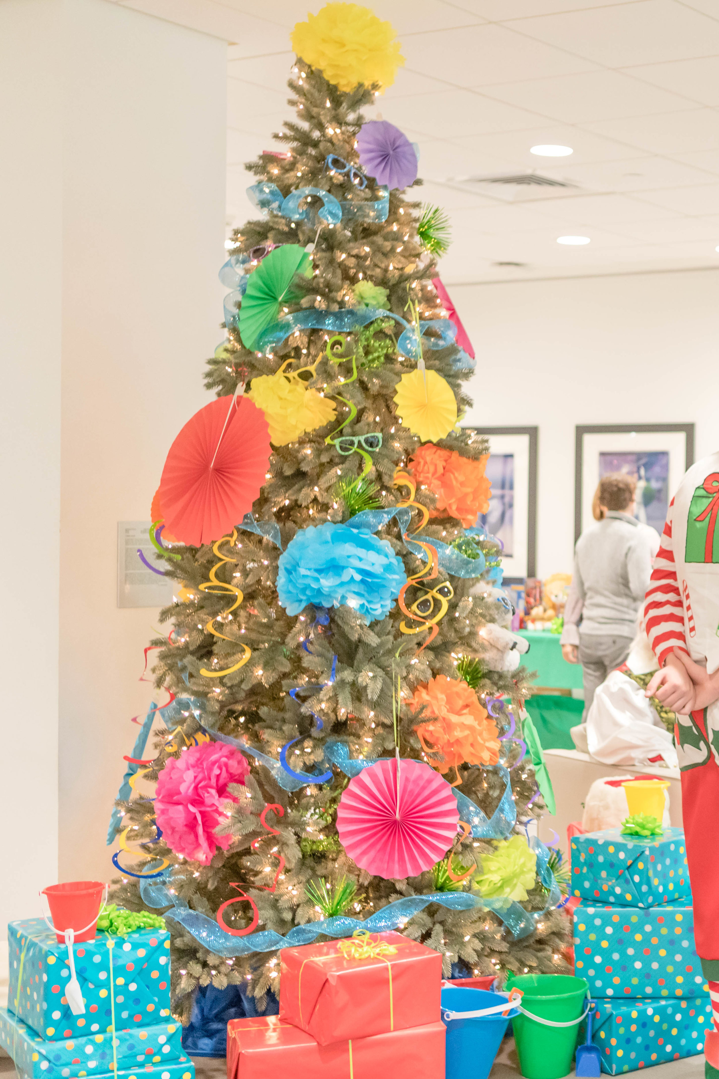 Who said summer & Christmas don't mix! Our summer fun tree, decked out in all the seasons finest, most fun colors. This 9ft. blue spruce was gifted by  Tree Classics .