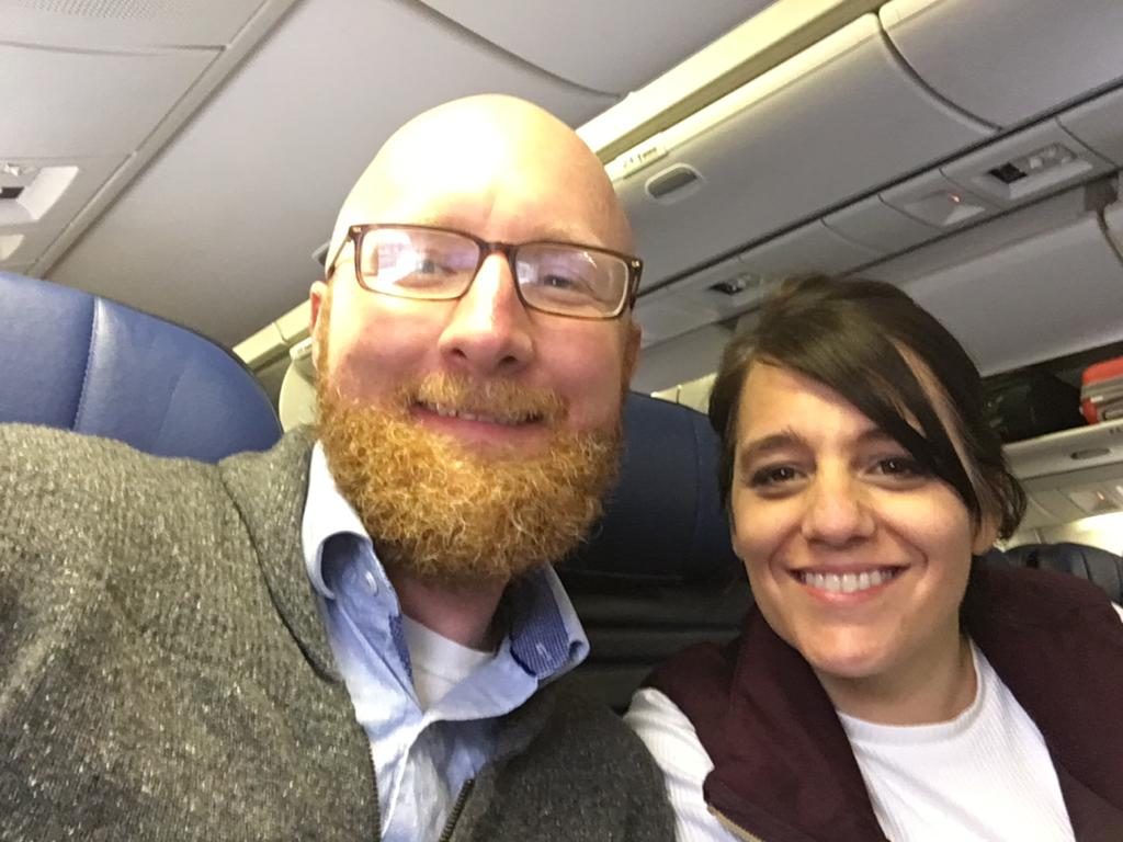 On our return flight. Dressed in layers… definitely bring layers if you're traveling to the UK in spring. The Brits may be wearing shorts, but I was happy with layers—and always a rain jacket and scarf on hand! #crappyiphonepic