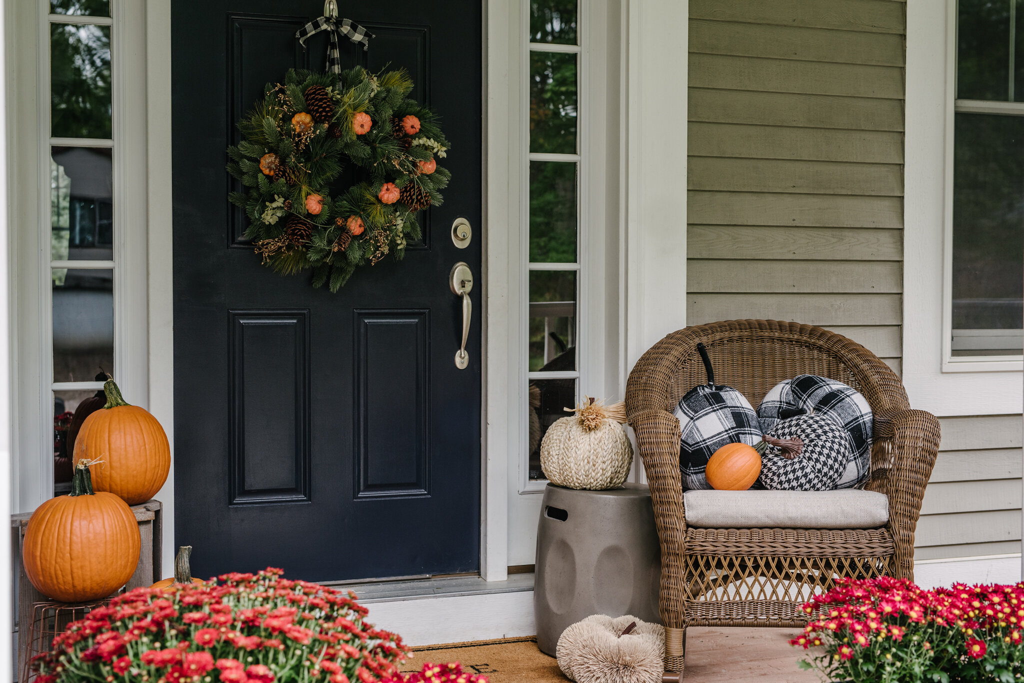 It's amazing what a bit of color and texture adds. Real pumpkins and mums from our local nursery and Walmart. Wreath and Garland via Tree Classics, and I added mini faux pumpkins from the Target Dollar Bin.