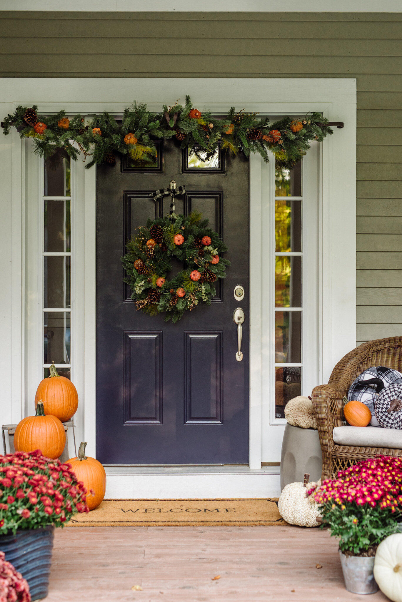 Rachel's front porch decorated with a mix of real and faux pumpkins, fall mums, and  Classic Fraser Fir Festive Wreaths and Garland