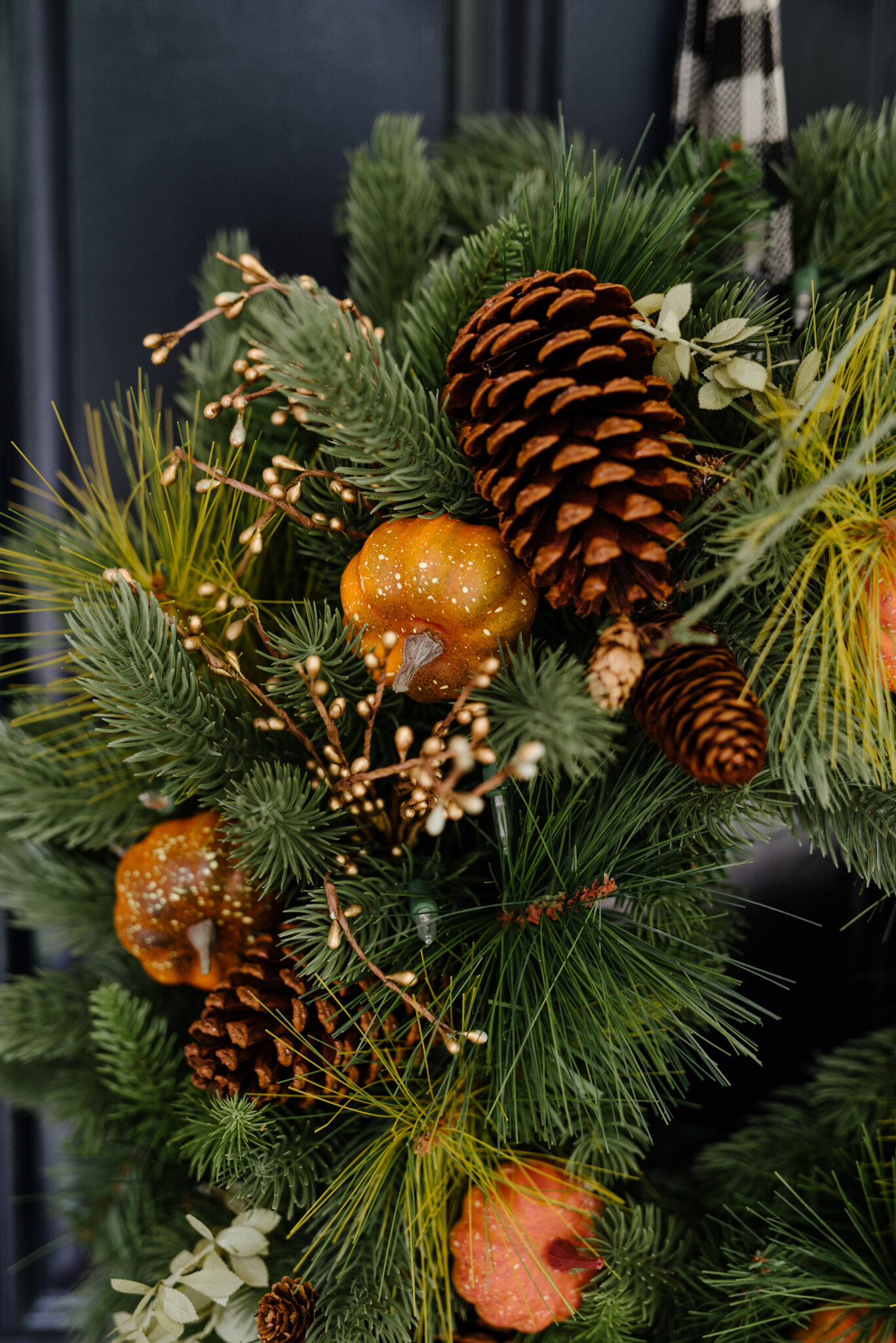 Tree Classics  Classic Fraser Fir Festive Wreath . The wreath comes decorated with tiny gold buds, faux leaves, pinecones and real feel needles. I added the faux pumpkins for a bit of a fall touch.