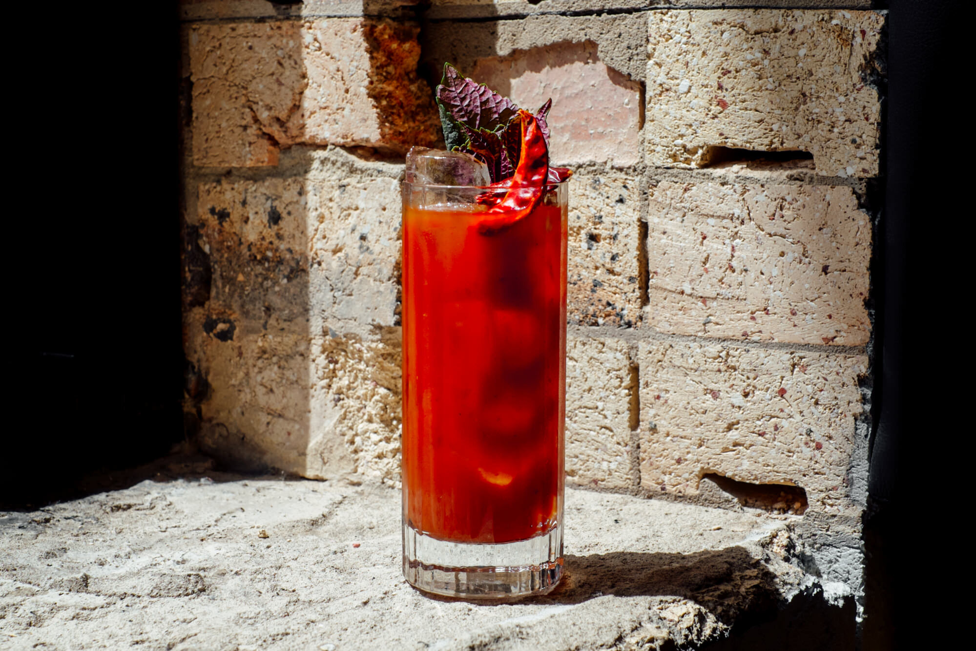 CHINESE BLOODY MARY:  Vodka, Sichuan Pepper, Chilli Black Bean, Tomato, Shiso