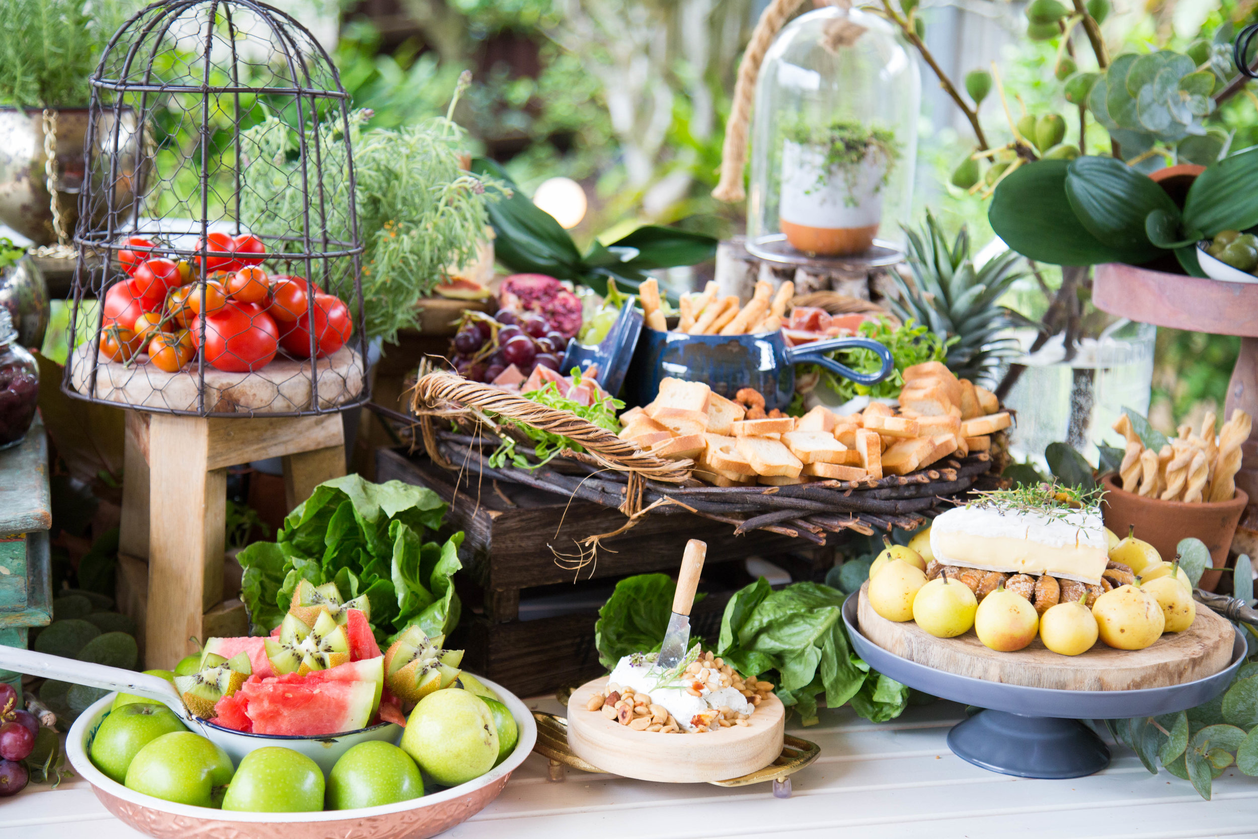 Make sure your grazing table is visual in taste and appeal  Like a buffet your grazing table should flow, fill in with greenery, fruit, vegetables and leaves.