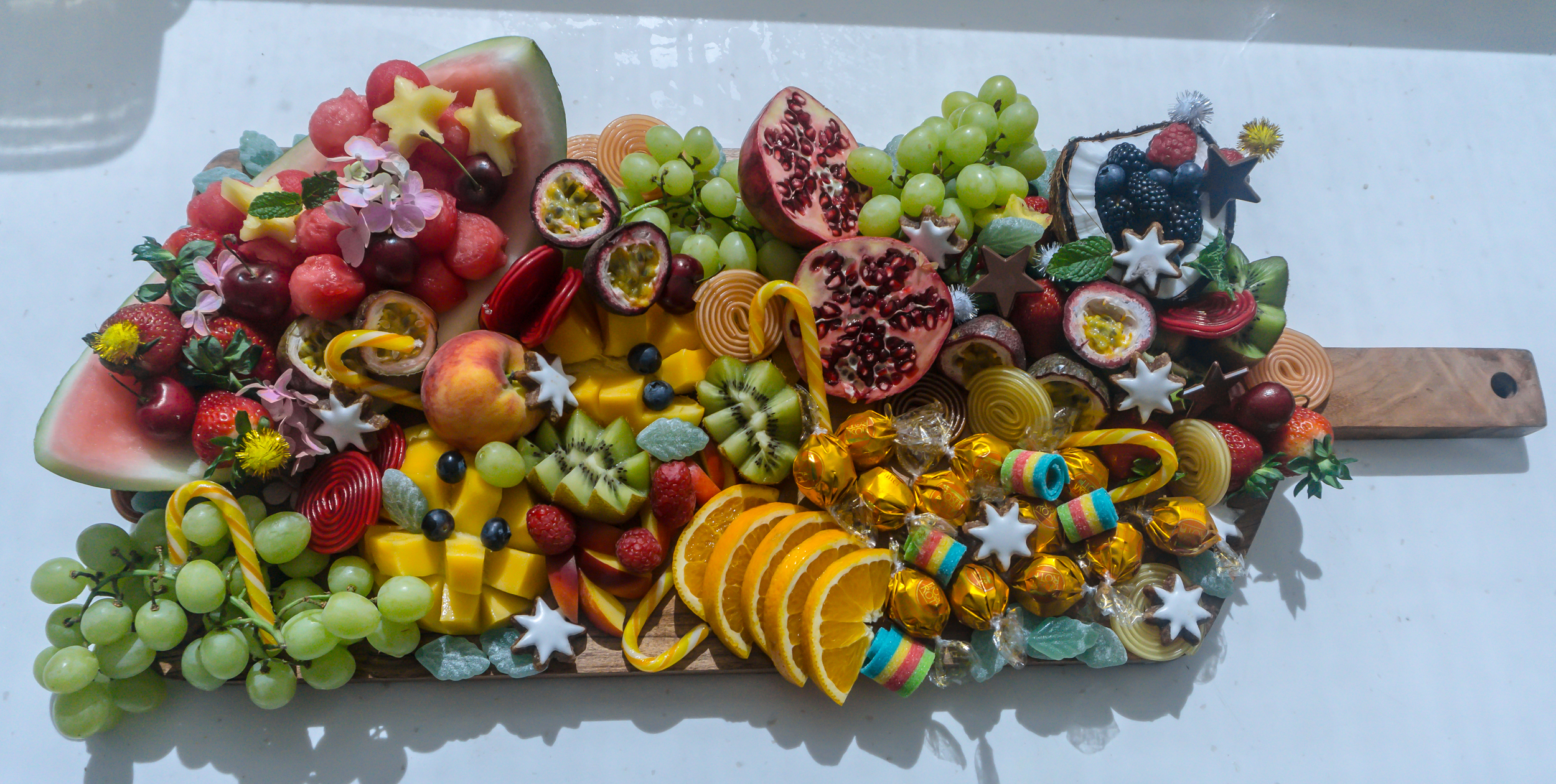 Fancy Fruit Board: a recent Christmas inspired fruit board I created. Same rule of thumb work with your 'bigger items' on the end of your board and work your way inwards with smaller items