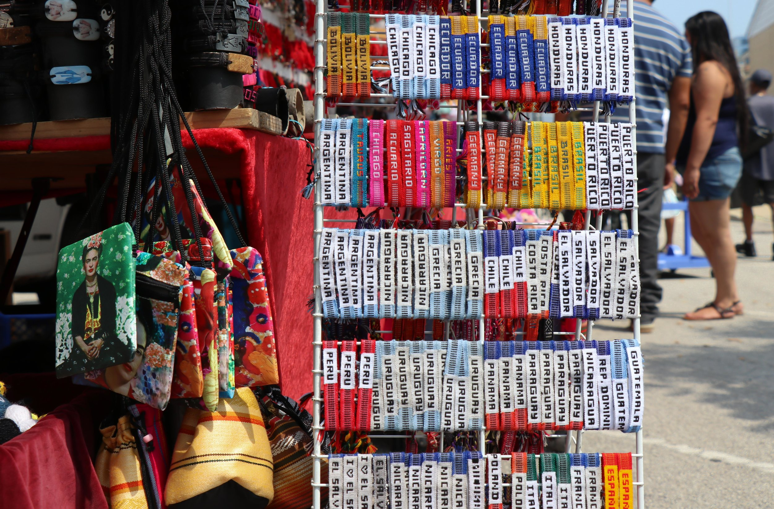 Handcrafted wristbands on sale, next to Frida-Kahlo-printed kitschy sling purses. Maxwell Street Market, South Desplaines Street. Chicago, 2018. (Vangmayi Parakala/MEDILL)