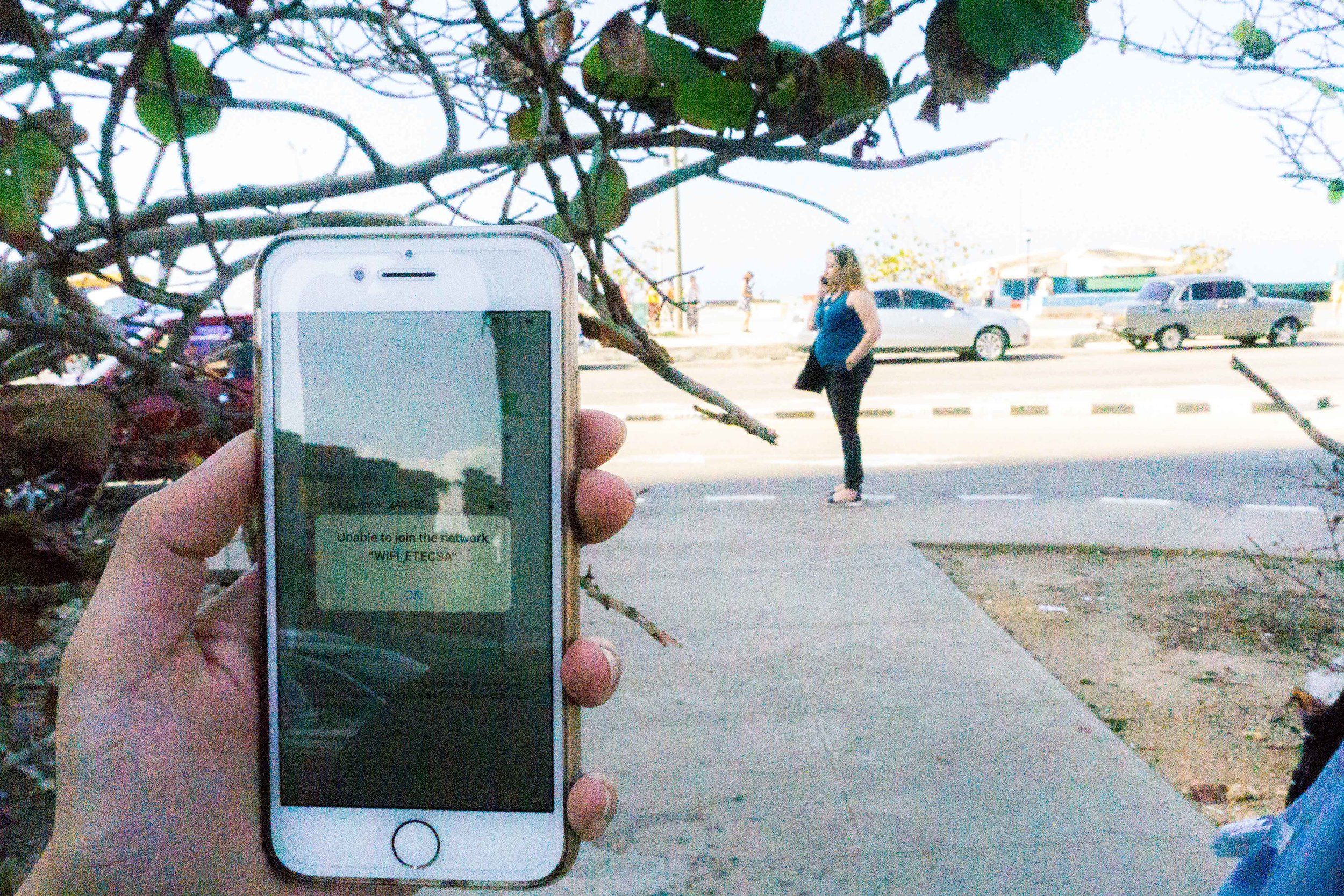 A shot of an iPhone trying to connect to the ETECSA wifi, at a government-approved internet park. When the public wifi works, Havana residents can catch up on news of friends and the world. But the connection can be finicky. (Vangmayi Parakala/MEDILL)
