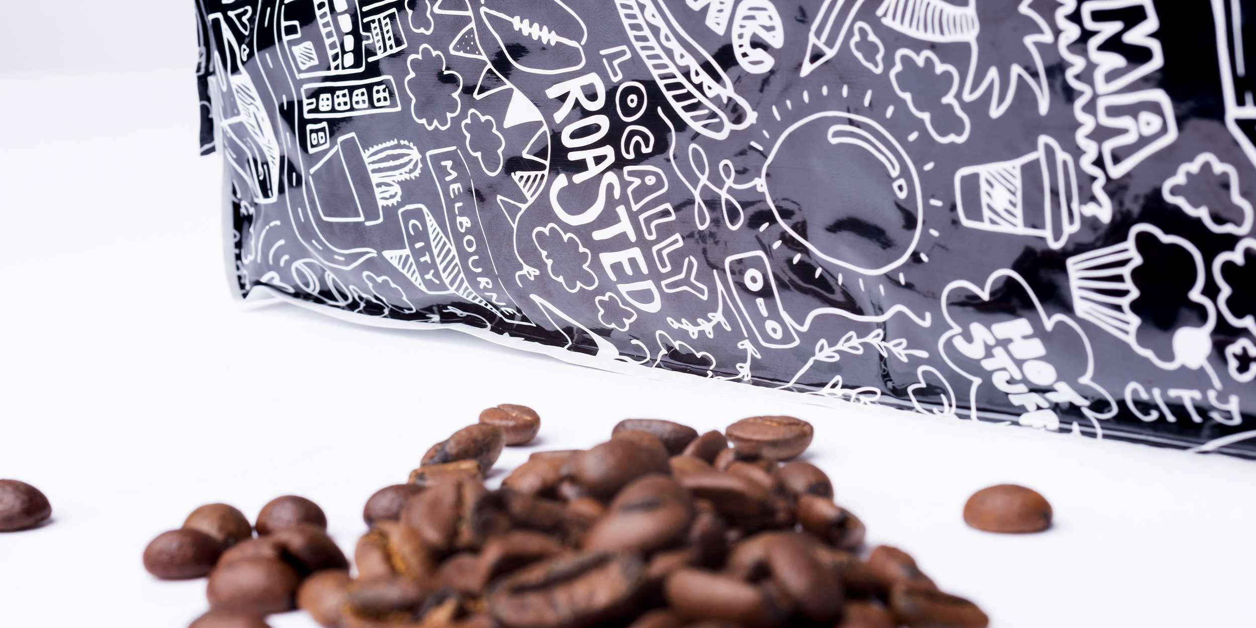 Inner Circle bespoke hand drawn pattern on packaging close-up with coffee bean background
