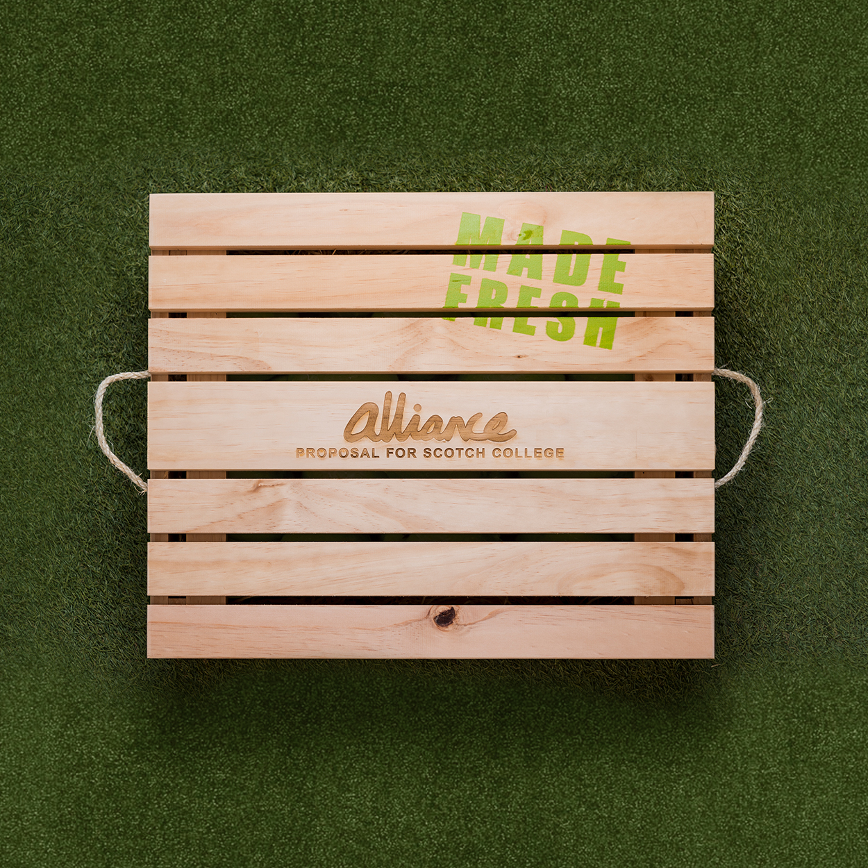 Alliance rebranded packaging tender box on grass background