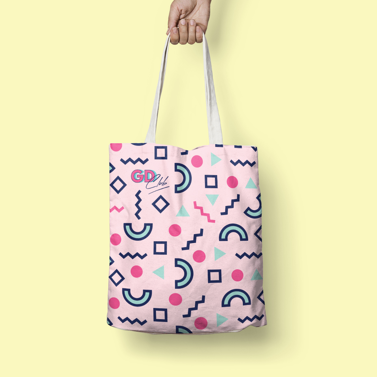 Hand holding Good Day Club tote with custom pattern
