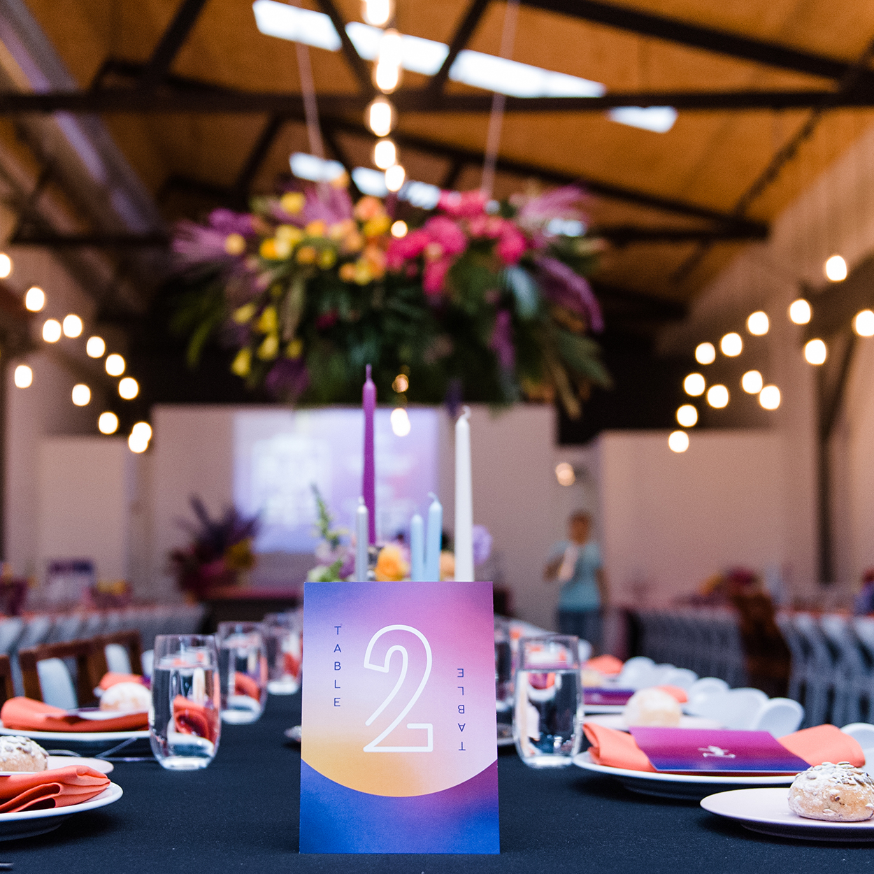 Wedding table number sign with custom typography sitting on table