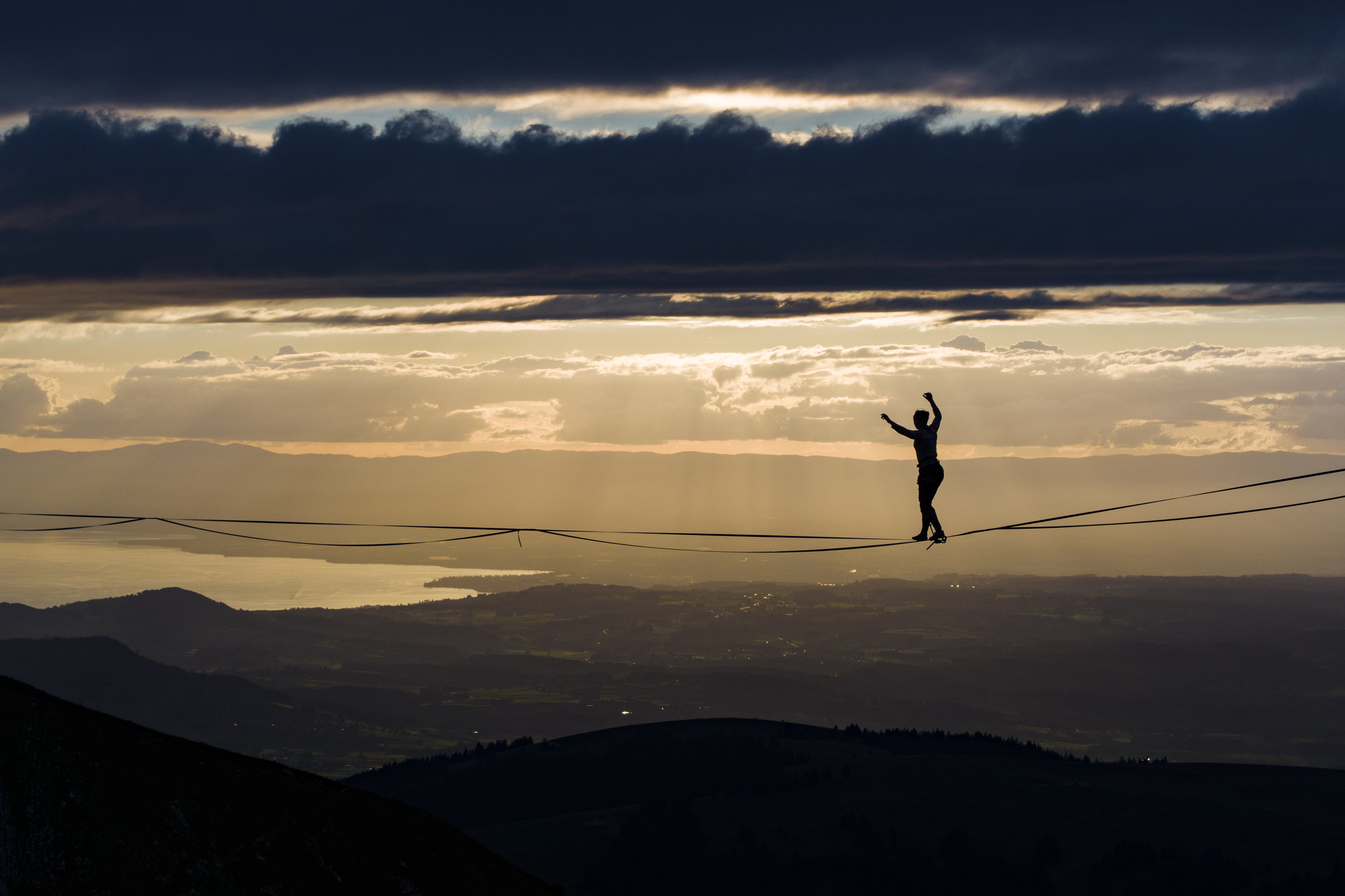 """British professional highliner Sarah Rixham  performs during the Highline Extreme event on the top of the Moleson peak at 2000 meters above the sea level, in the Swiss Alps, near Fribourg, Switzerland, Friday, September 15, 2017. 25 of the world best slackliners compete until September 17, on 6 different lines ranging from 45 metres to 350 metres. Balancing on the """"slackline"""" is a training method for climbers to improve their equilibrium sense. To avoid the danger of falling down, the athlete is secured with a rope. (KEYSTONE/Valentin Flauraud)"""