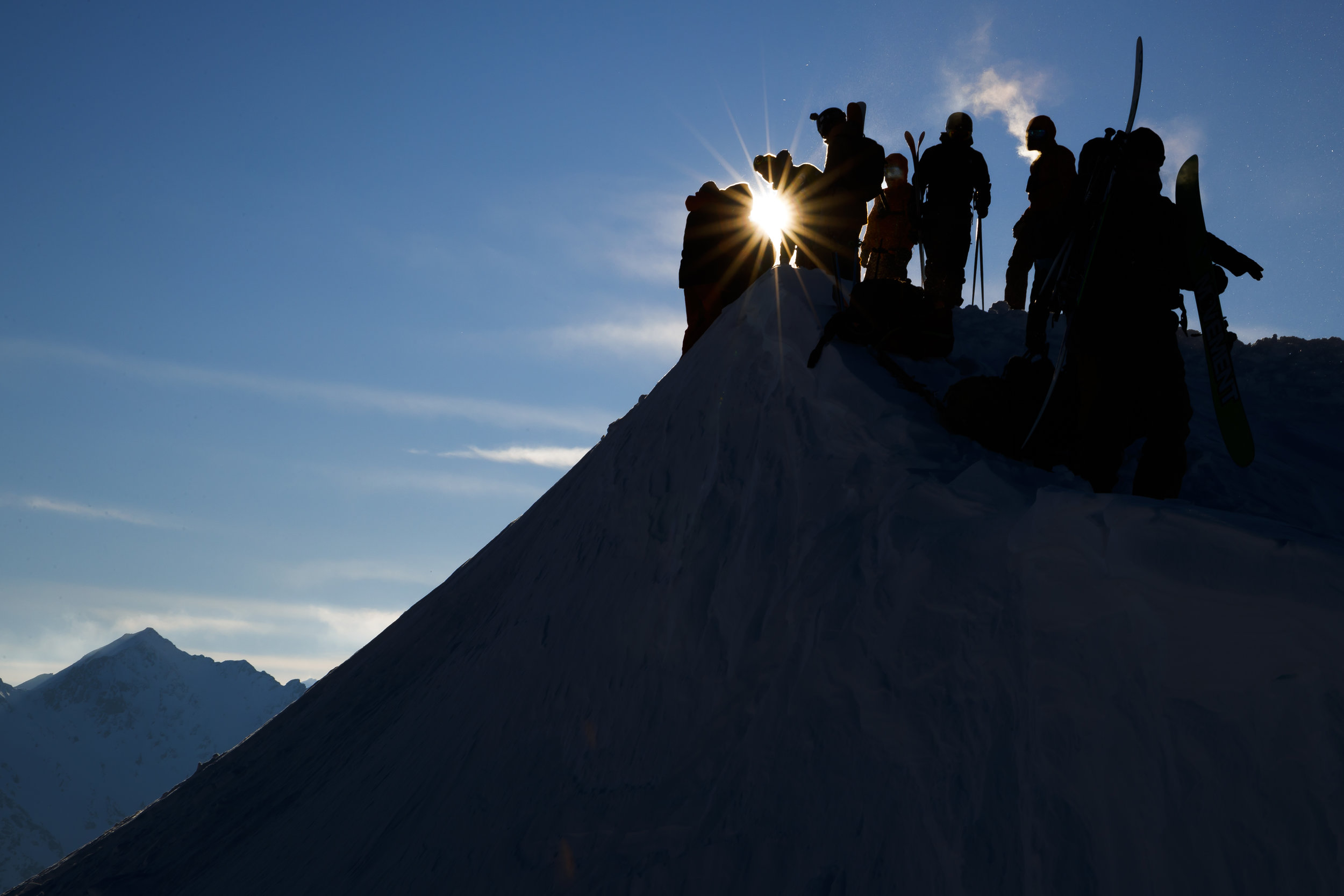 Technical staff prepare the start area prior to the Nendaz Freeride ski and snowboard competition, a Freeride World Tour Qualifier (FWQ) event, on the Mont Gond in Nendaz, Switzerland, Wednesday March 21, 2018. (KEYSTONE/Valentin Flauraud)
