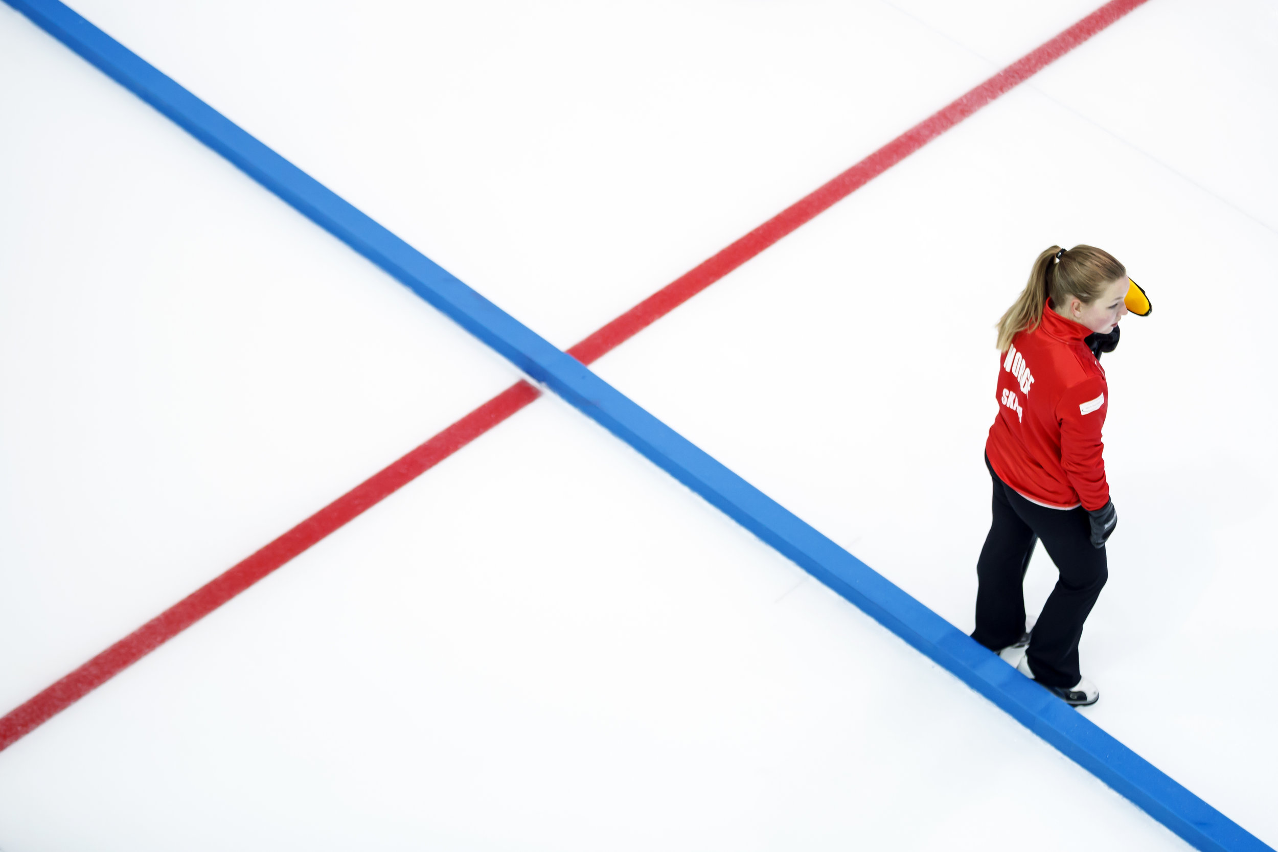 Norway team skip Ingvild Skaga waits to deliver a stone during the semi-final game between Norway and Canada at the World Mixed Curling Championship (WMCC) at the Palladium Ice Arena, in Champery, Switzerland, Saturday, October 14, 2017. (KEYSTONE/Valentin Flauraud)