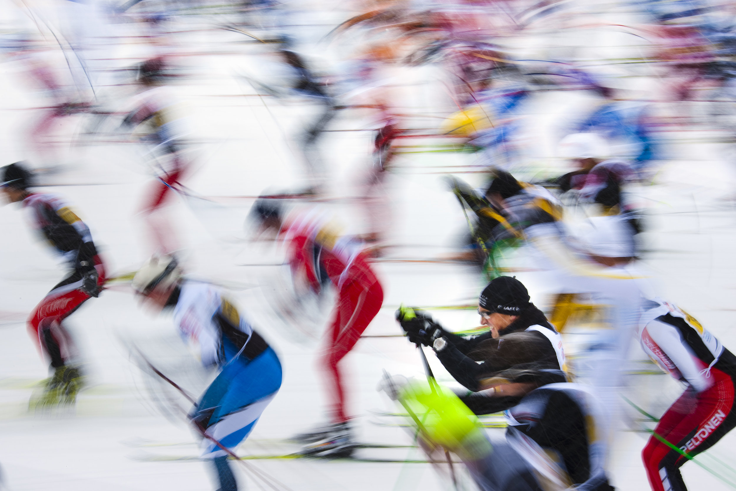Cross country skiers take their start to race over the frozen lake Sils during the Engadin Ski Marathon near Sils March 13, 2011. More than 11'900 skiers registered in the 42.2 km race between Maloja and S-chanf near the Swiss mountain resort of St. Moritz. REUTERS/Valentin Flauraud (SWITZERLAND)