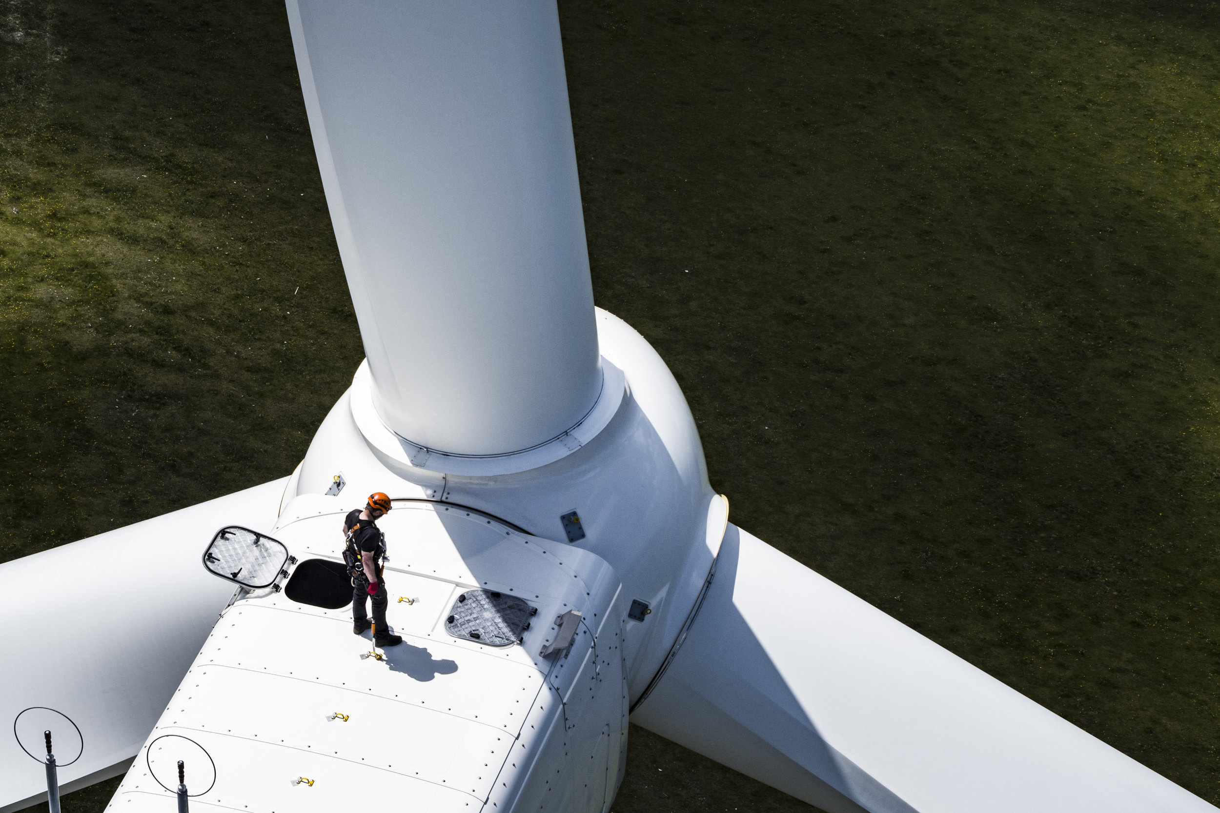 """Pierre Berger, JUVENT employee in charge of security and maintenance stand on a wind turbine of 150m overall height at the JUVENT power plant on the Mont-Soleil in Saint-Imier, Switzerland on Wednesday May 10, 2017. The Swiss people will be voting on the """"federal law on energy"""" on May 21 2017.Pierre Berger, employe de JUVENT en charge de la securite et maintenance est photographie debout sur une eolienne de 150m de hauteur totale ce mercredi 10 mai 2017 au Mont-Croset a Saint-Imier dans le Jura Bernois. Le 21 mai 2017 le peuple suisse va voter sur la loi federale sur l'energie (LEne). (KEYSTONE/Valentin Flauraud)"""
