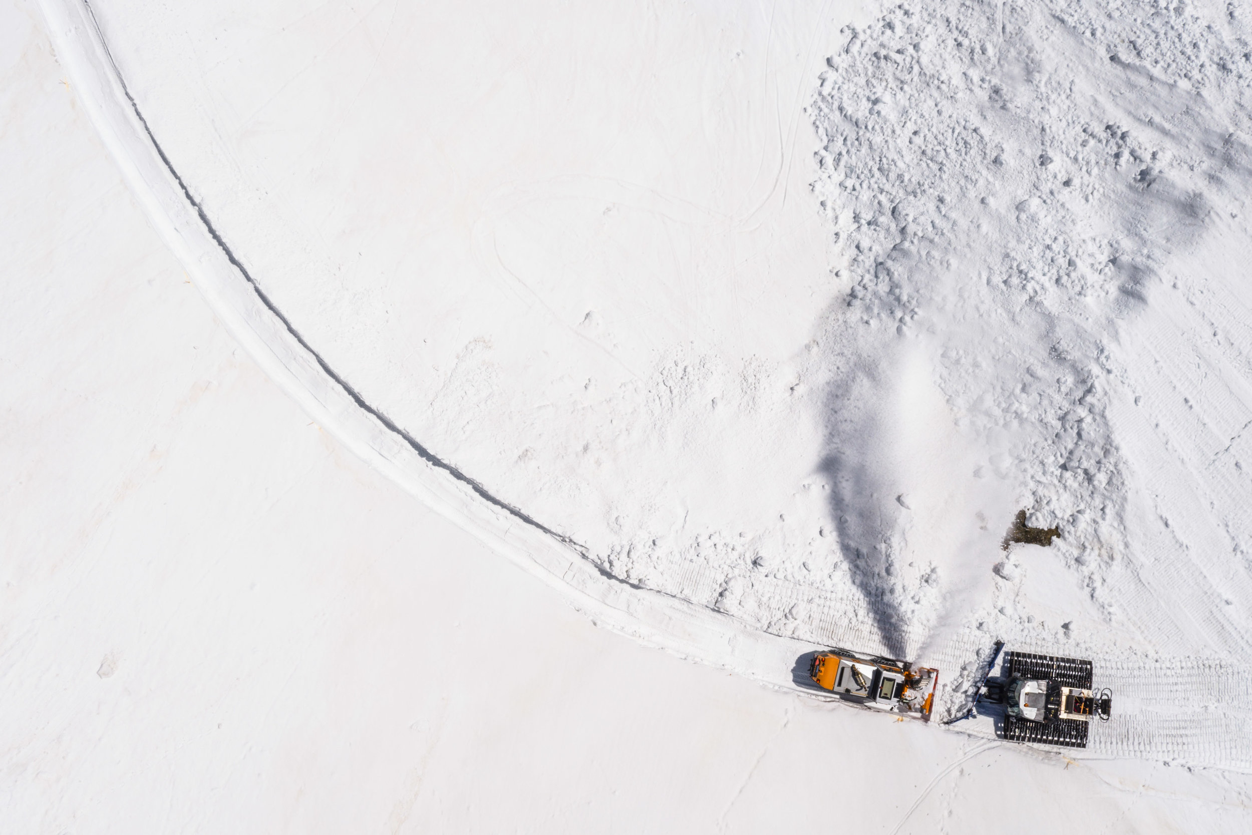 Snow ploughs are pictured clearing snow off the road at the Great St. Bernard pass, Switzerland, Tuesday May 16, 2017. The snow ploughs and snow blowers make their way slowly through the mountain every spring and will have carved through layers several meter-deep during a four-week operation this year. The Col du Grand-Saint-Bernard, in French, is the third highest road pass of Switzerland and connects the canton of Valais to Italy. (KEYSTONE/Valentin Flauraud)