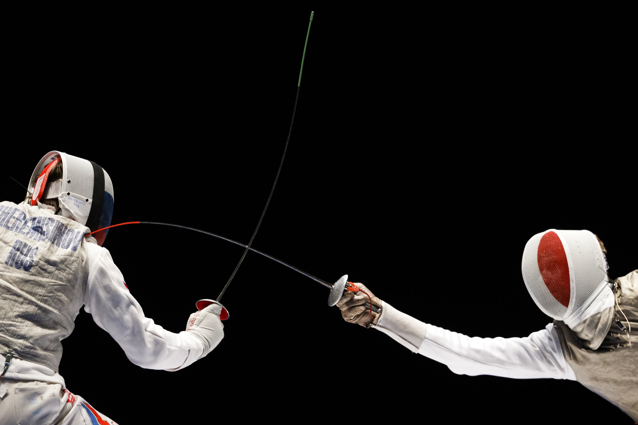 Arthur Akhmatkhuzin from Russia from Russia, left, reacts next to Julien Mertine, right,  from France during the men's team foil final at the European Fencing Championships in Montreux, Switzerland, Tuesday, June 9, 2015. (KEYSTONE/Valentin Flauraud)