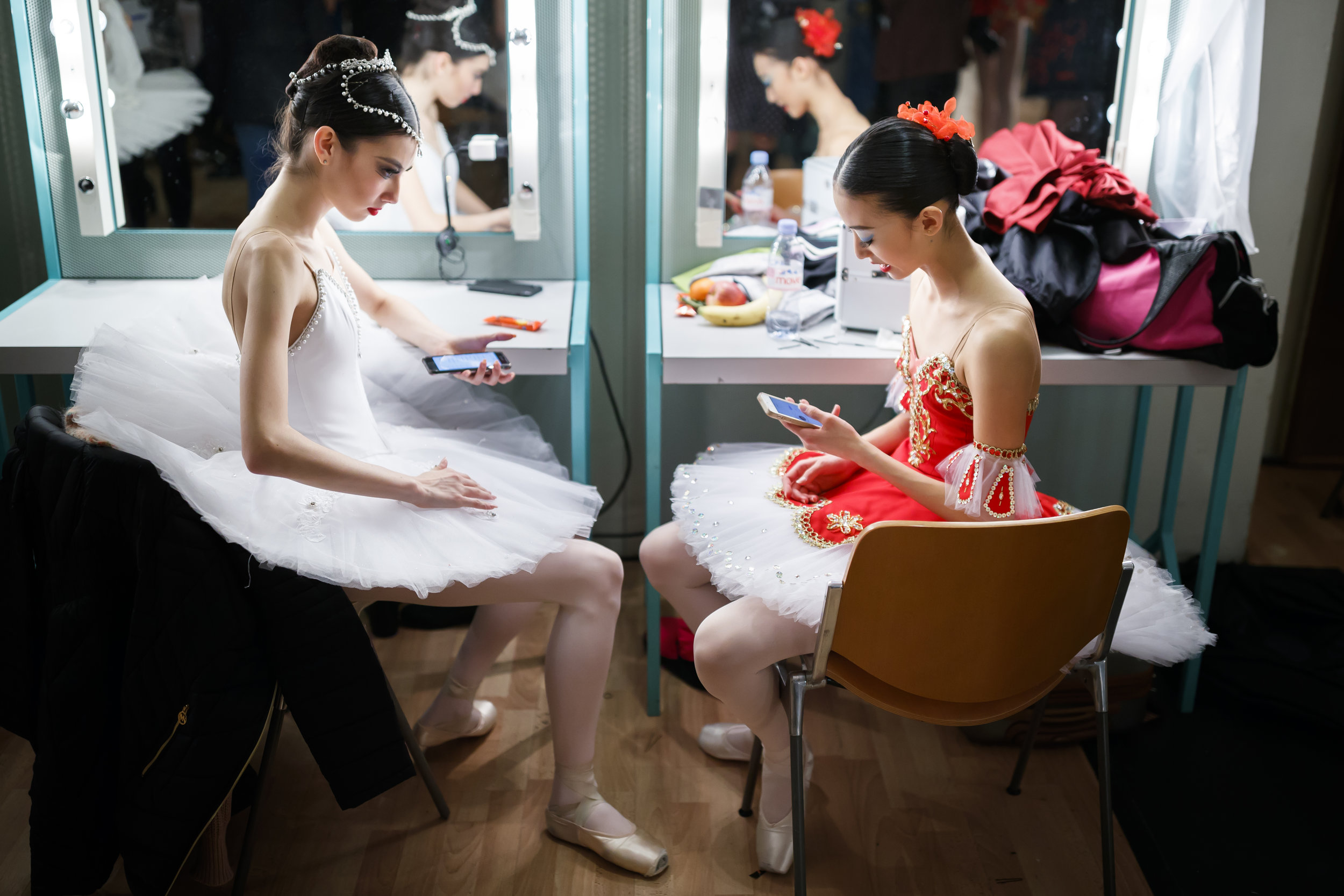 Dancers use their mobile phones backstage as they wait for their final results after the final of the 46th Prix de Lausanne in Lausanne, Switzerland, Saturday, February 3, 2018. Launched in 1973, the Prix de Lausanne is an international dance competition for young dancers aged 15 to 18. Closing the six-day event, prizes are awarded to the best of 21 finalists consisting of scholarships granting free tuition in a world-renowned dance school or dance company. (KEYSTONE/Valentin Flauraud)