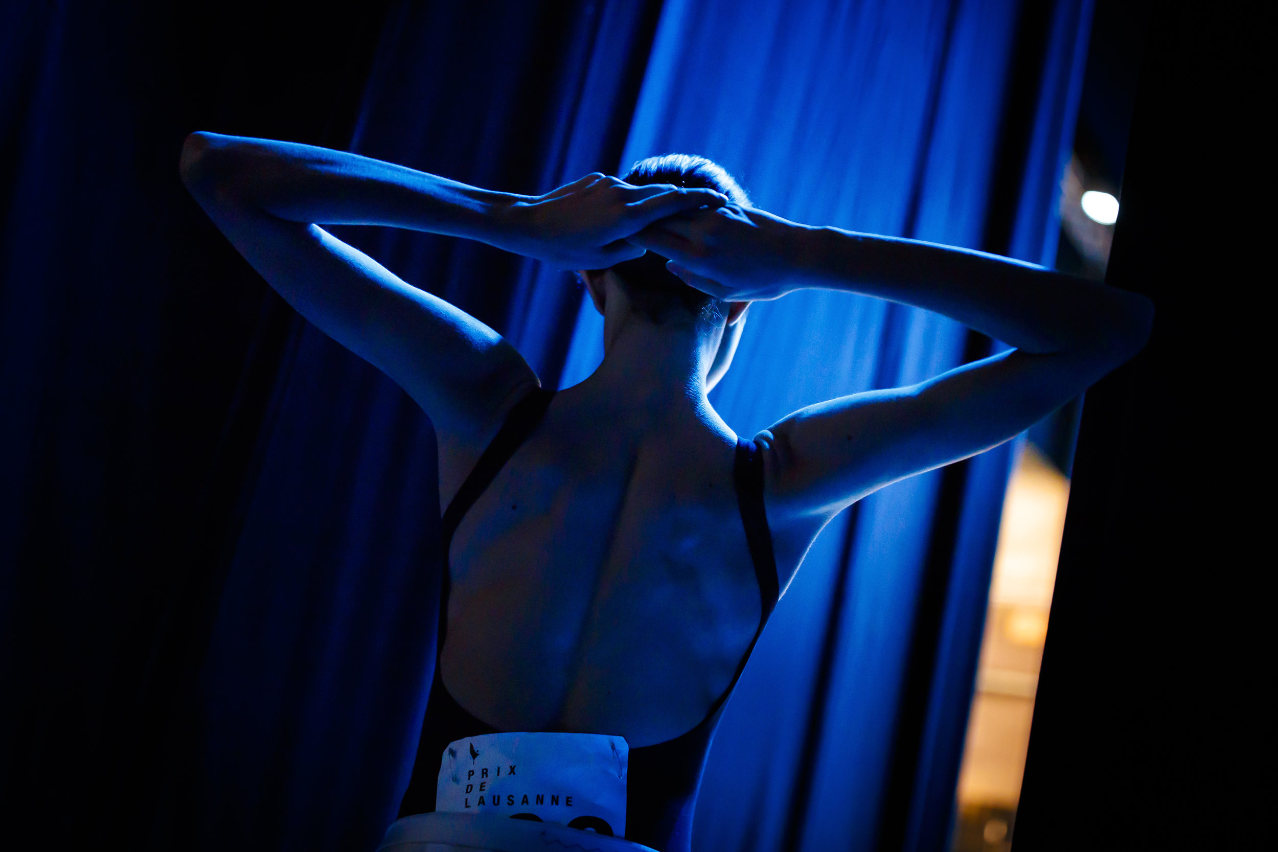 A dancer waits prior to stepping on stage during the first day of the 47th Prix de Lausanne in Lausanne, Switzerland, Monday, February 4, 2019. Launched in 1973, the Prix de Lausanne is an international dance competition for young dancers aged 15 to 18. Closing the six-day event, scholarships granting free tuition in a world-renowned dance school or dance company will be award to the best dancers out of 74 participants this year. (KEYSTONE/Valentin Flauraud)