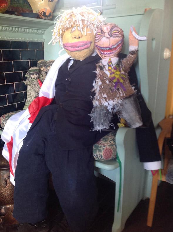 Balloon & papier mache Boris Johnson & Pinata Farage (post beating)