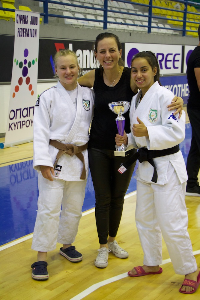Sofia Asvesta (left) & Vasiliki Kourri (right) pictured with Antigoni Leonidou - member of the Management Council of the Cyprus Judo Federation