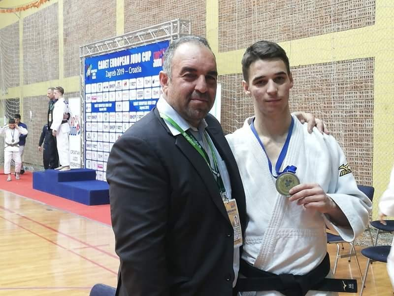 Bronze medalist Kyprianos Andreou pictured with coach and father Marios Andreou