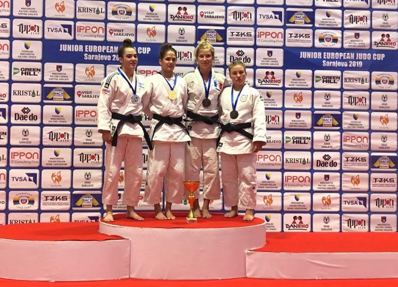 Sofia (right) on the podium for third place bronze medal