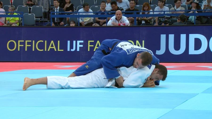 Christos Tricomitis in blue