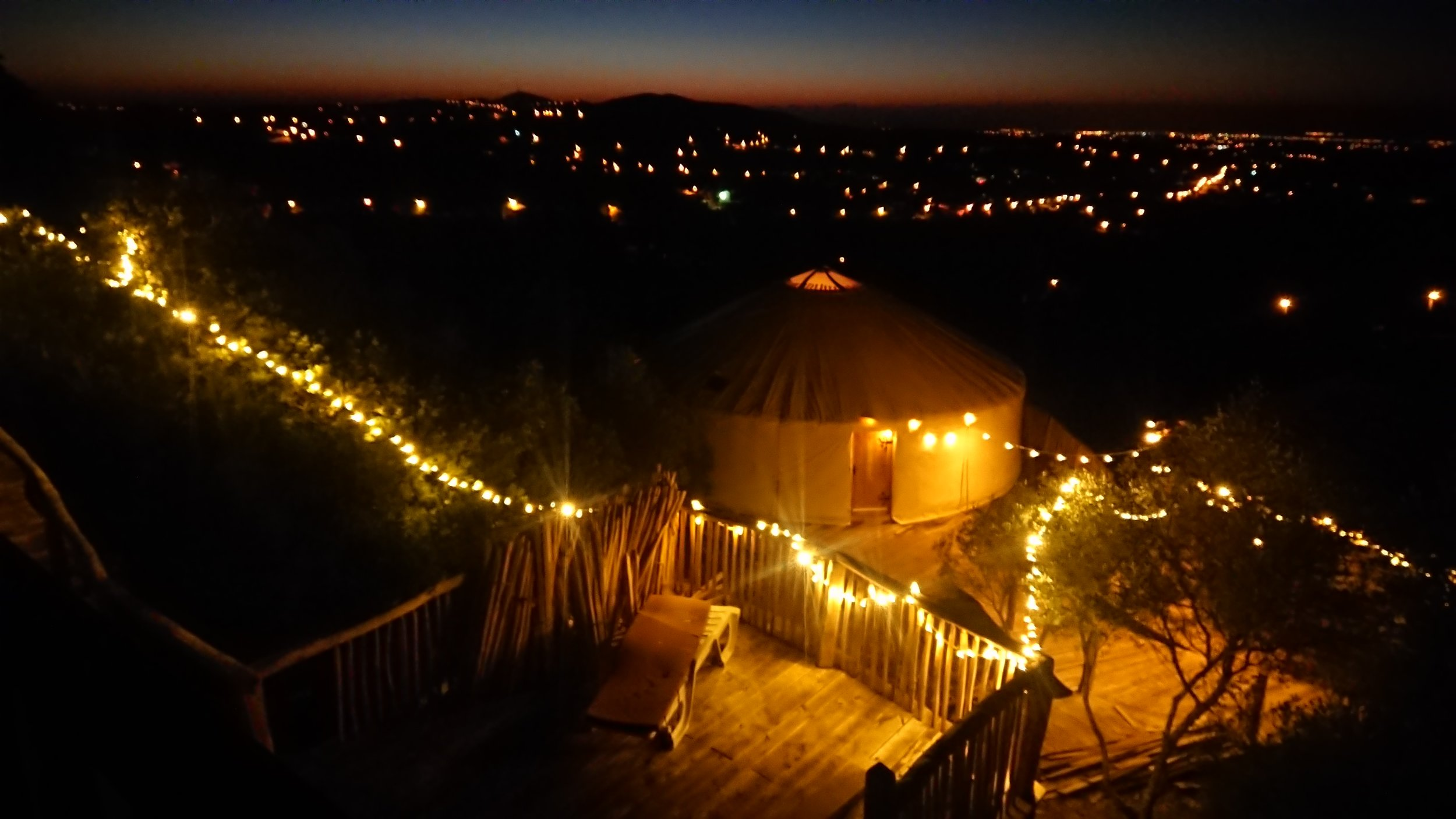 yurt and ecohut from pool area.JPG