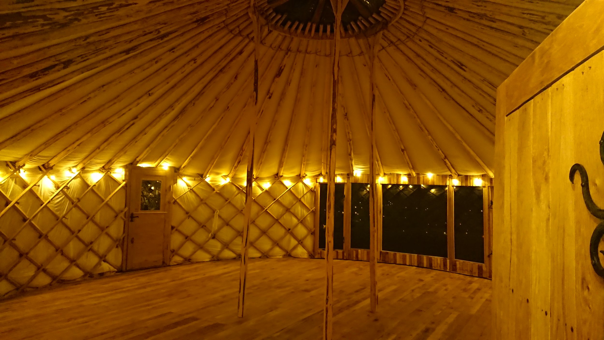 inside of beautifully crafted yurt.JPG