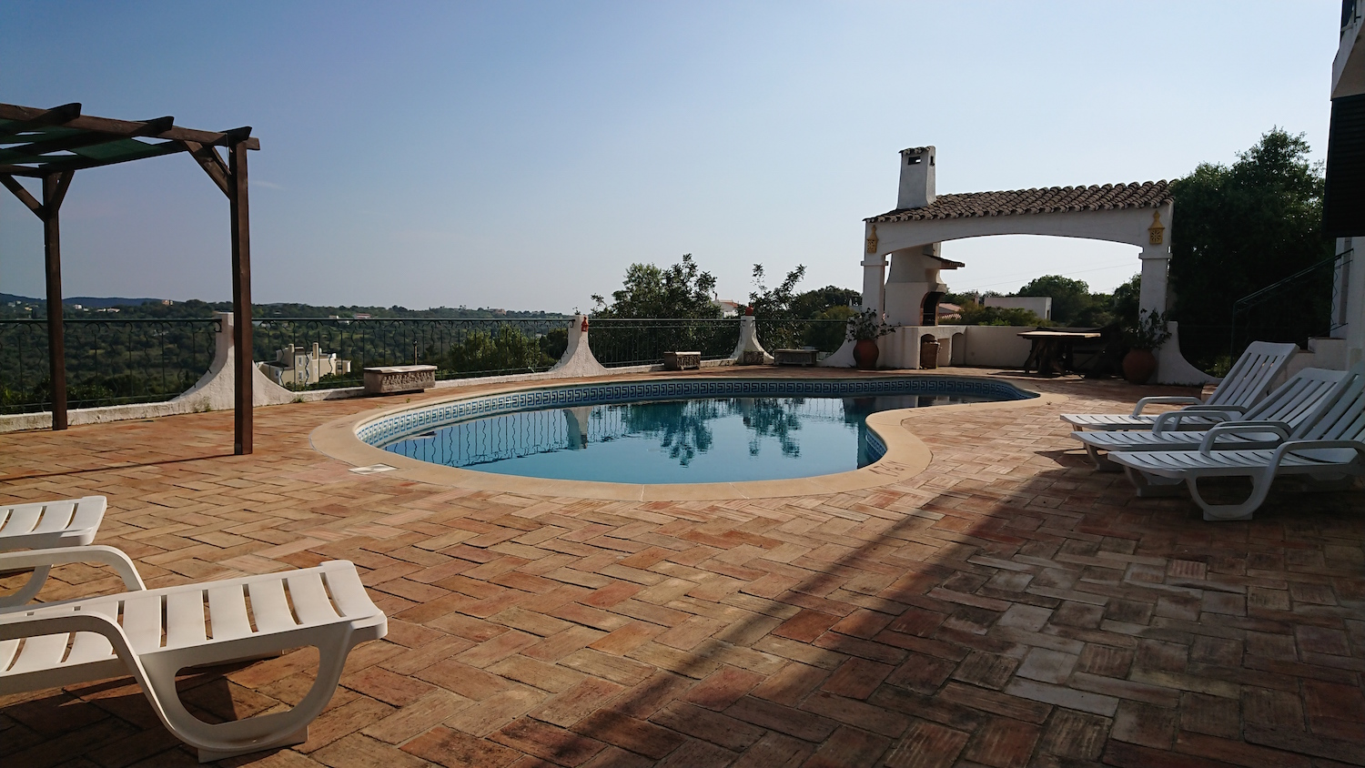 view of entire pool and pergola and bbq copy.jpg