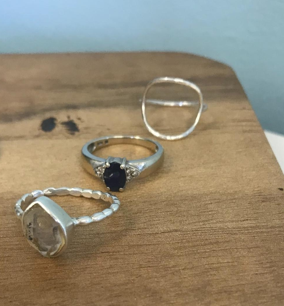 three-rings-lined-up-on-jewelry-block.jpg