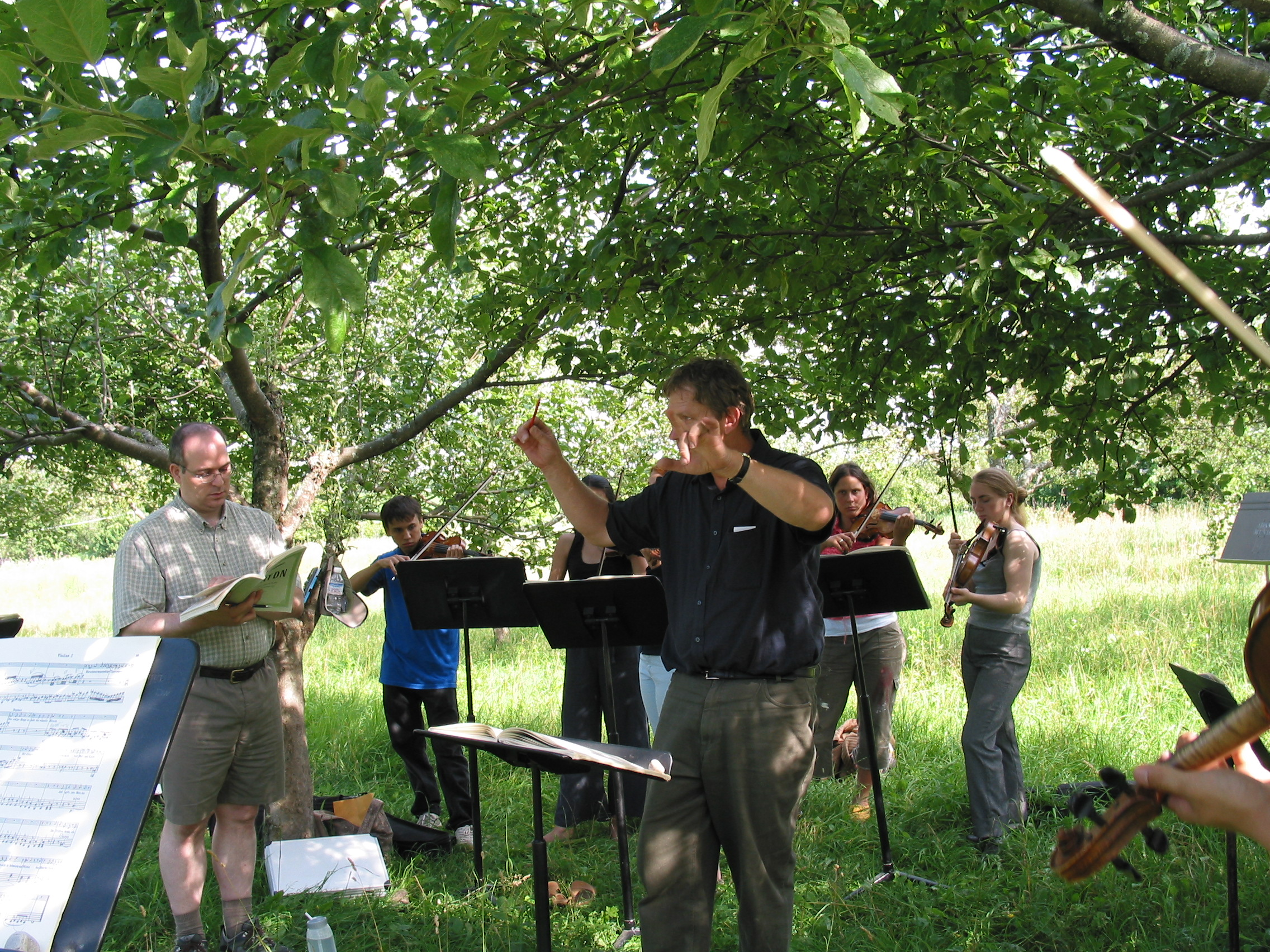 Michael and Musicians in Orchard.jpg