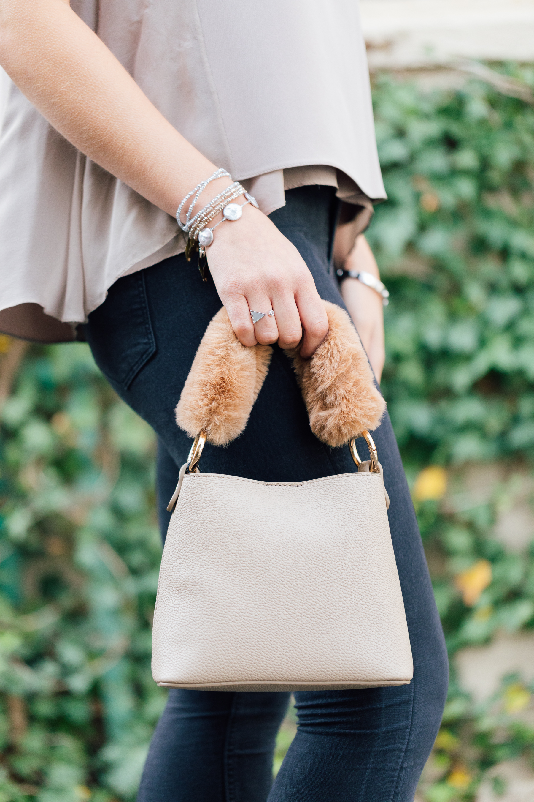 Un Billion's new Isabella bag--the fur handle is too much fun!--paired with Nyla Star's new Jo ring, and Pebbles by LLF stackables in the perfect colors for the upcoming holiday season.
