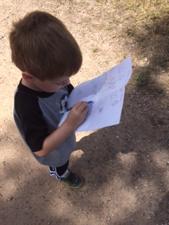 My son checking off his last item on the checklist.
