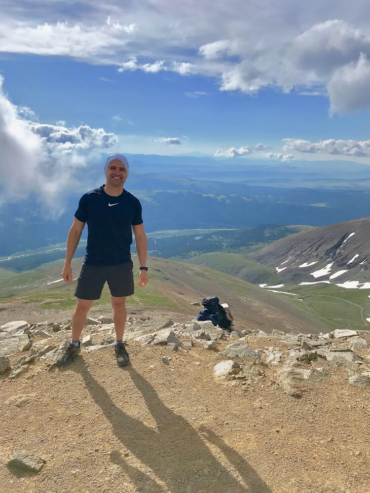 At the summit of my hike up Mt. Lincoln, the completion of my most recent Challenge.