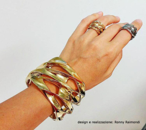 Silver rings from metal casting with gold plated bracelet.
