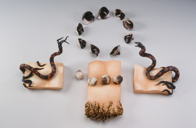 "Kali Lily Bodyscape 1980 earthenware 36 x 36 x 12""     A modular sculpture, for wall or pedestal.  Influenced by the Bay Area Figurative focus on bodies in connection with nature, interpreted literally with heads, feet, arms, torsos sprouting leaves, flowers, roots, wings."