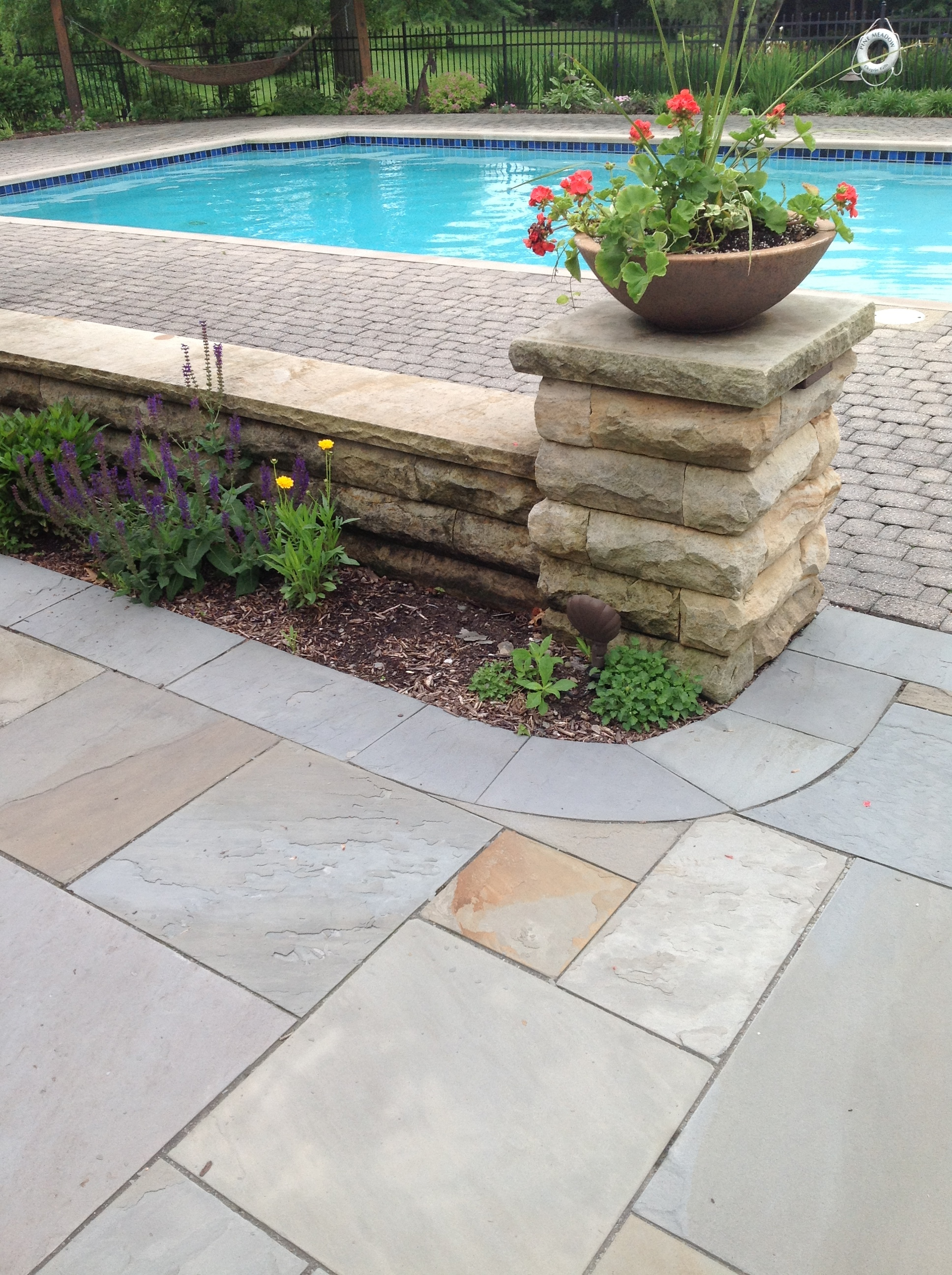 Landscape design improved with Unilock patio pavers and retaining wall Novelty, OH
