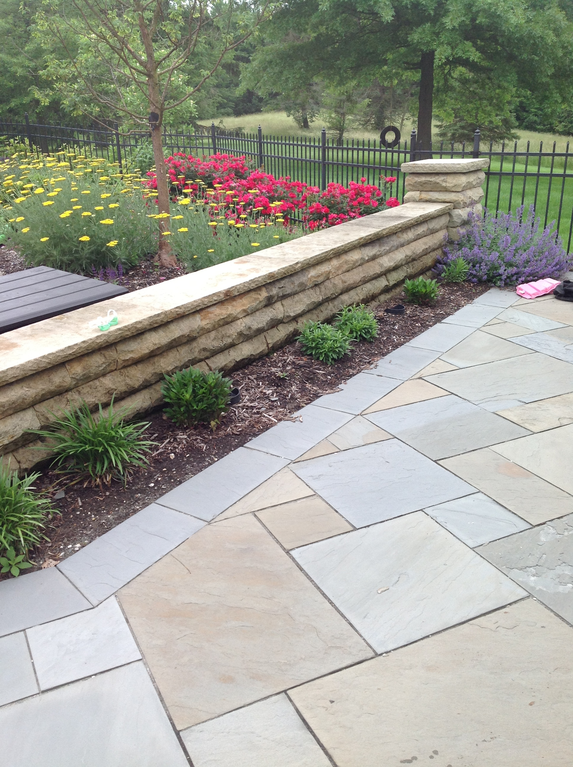 Patio pavers and retaning wall authorized by Unilock in Chagrin Falls, OH