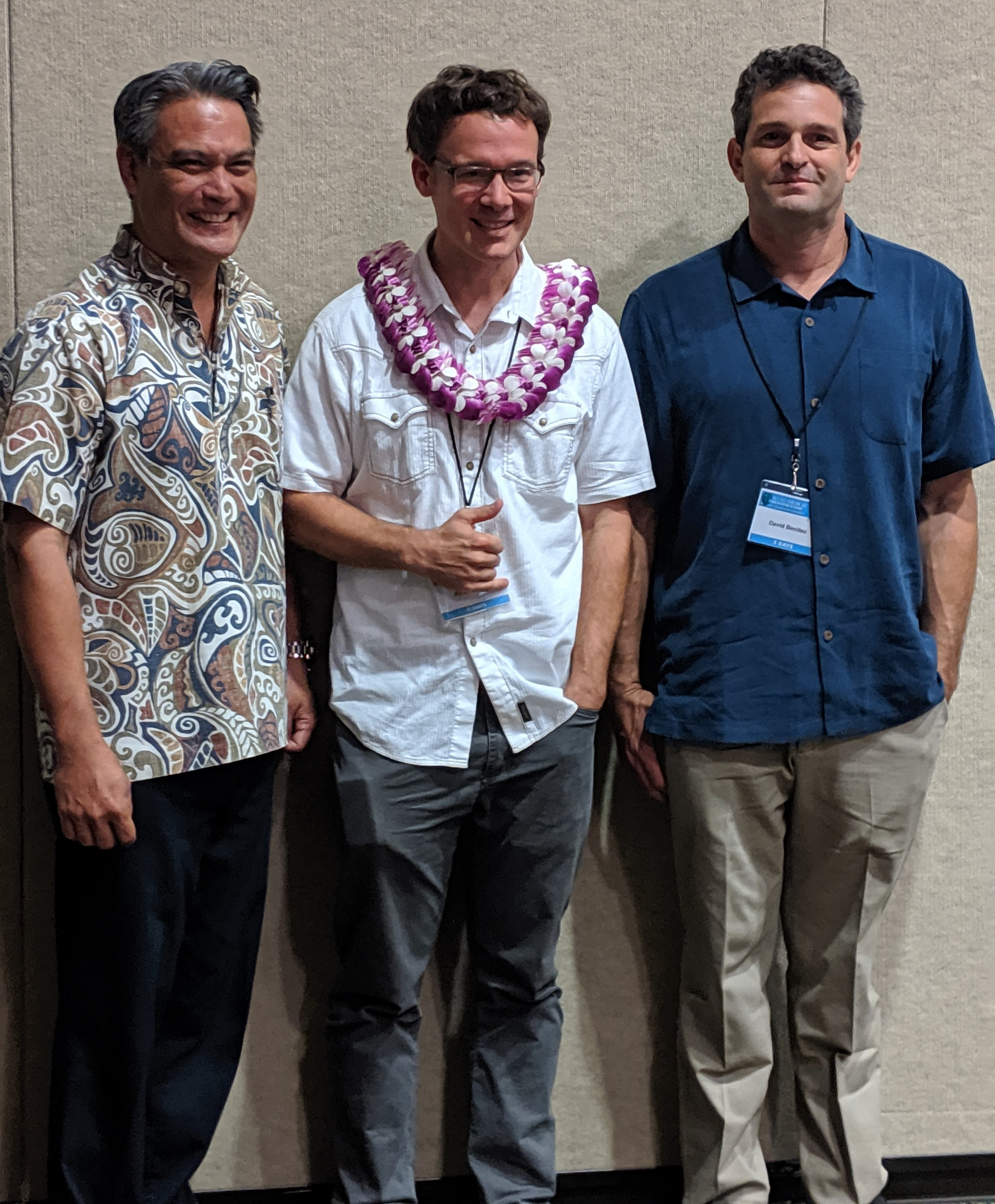 COURTESY DANNY DUDA / UH HILO  Ryan Perroy, an associate professor at UH Hilo, is the winner of the Ohia Challenge. Perroy, center, is standing next to Stanton Enomoto of the Department of the Interior's Office of Native Hawaiian Relations, left, and Hawai'i Volcanoes National Park ecologist David Benitez.