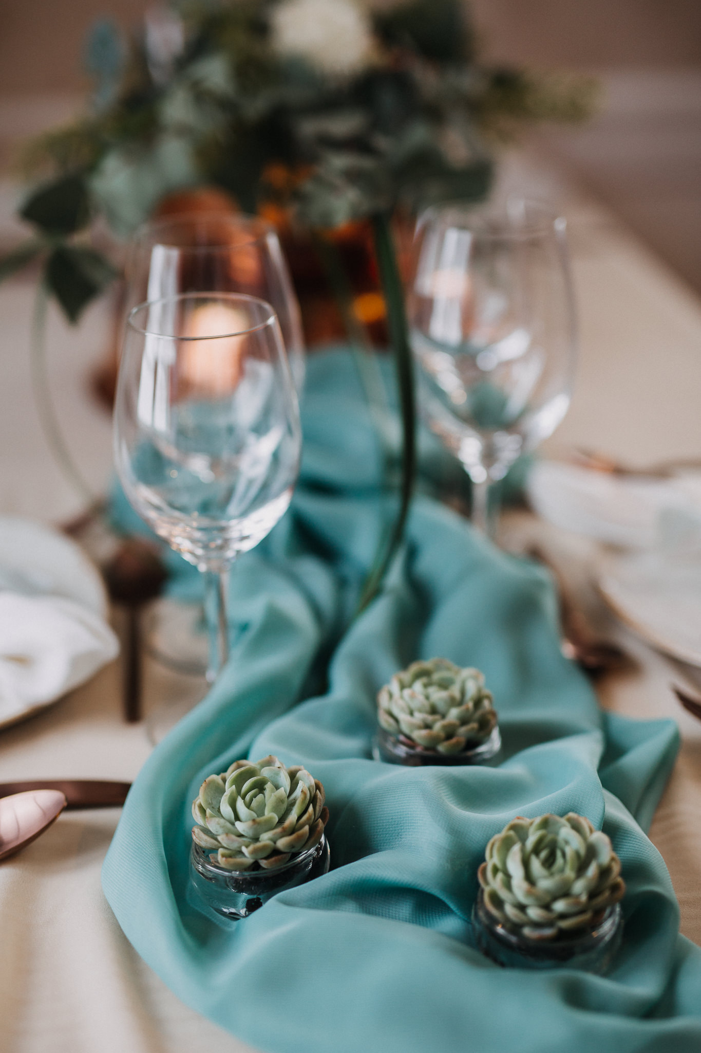 winter wedding table arrangements succulents.jpg