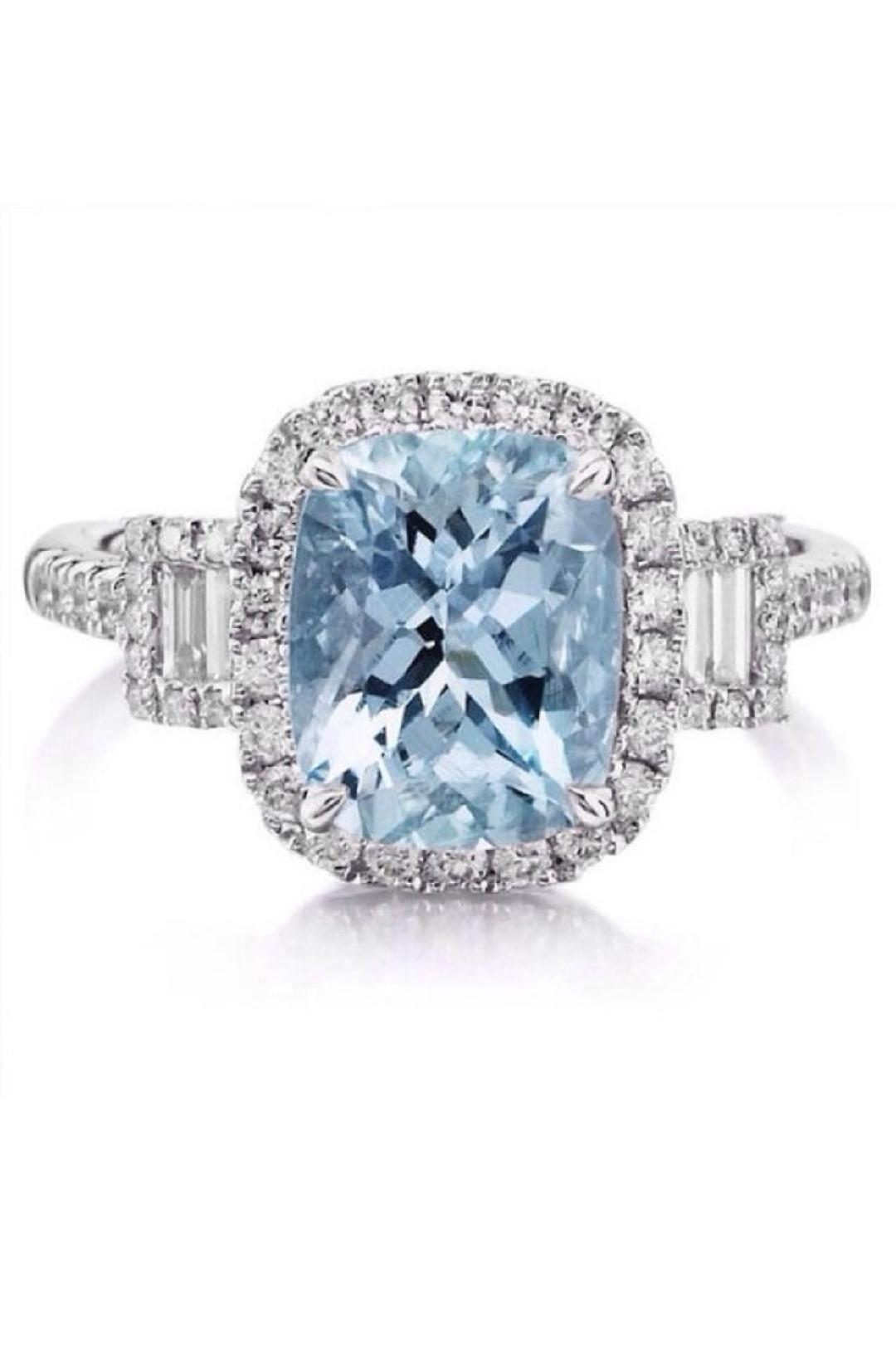 blue colored gems for the main stone enagement ring.jpg