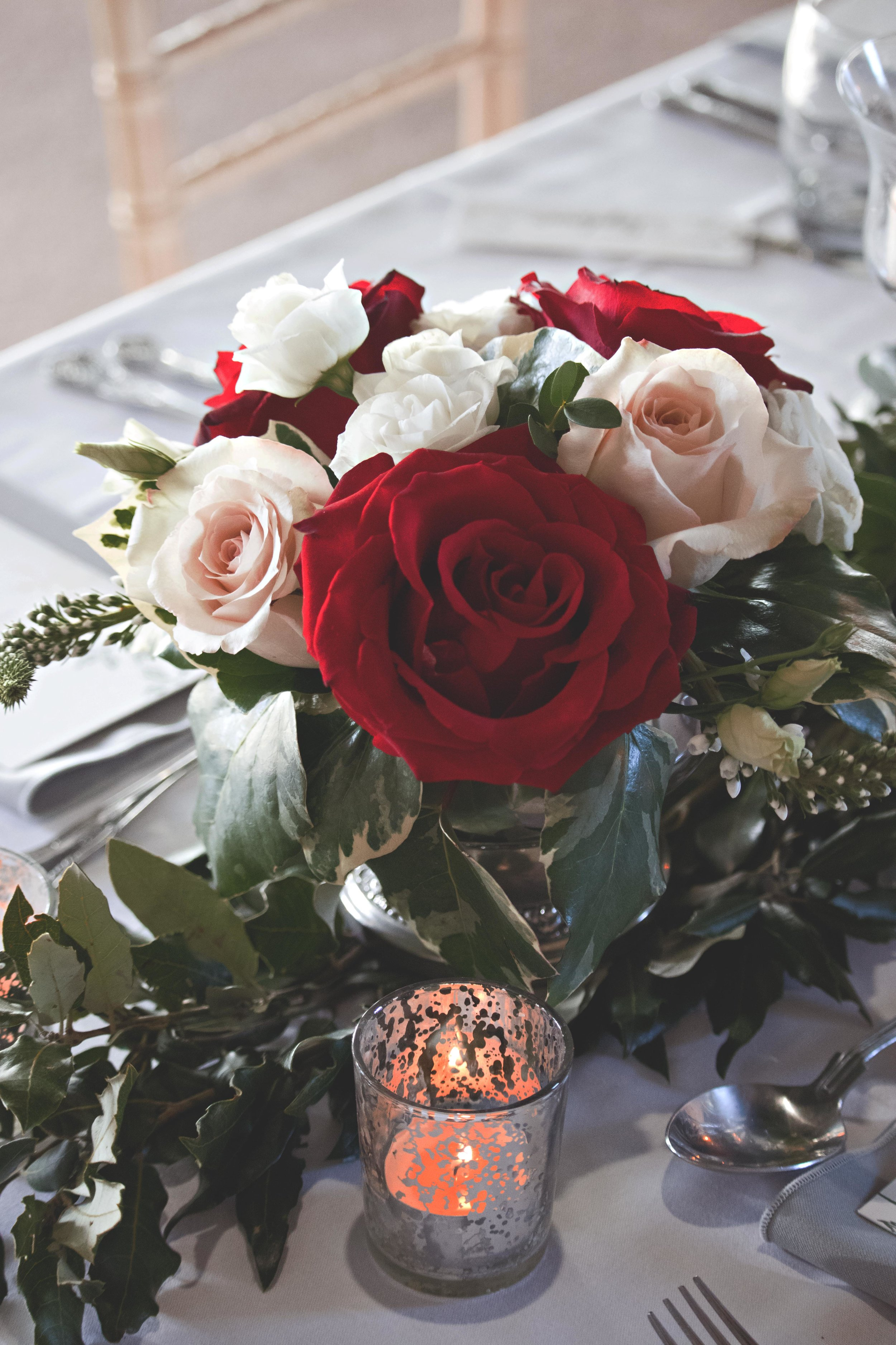 wedding flowers red roses and pale pink roses walton castle.jpg