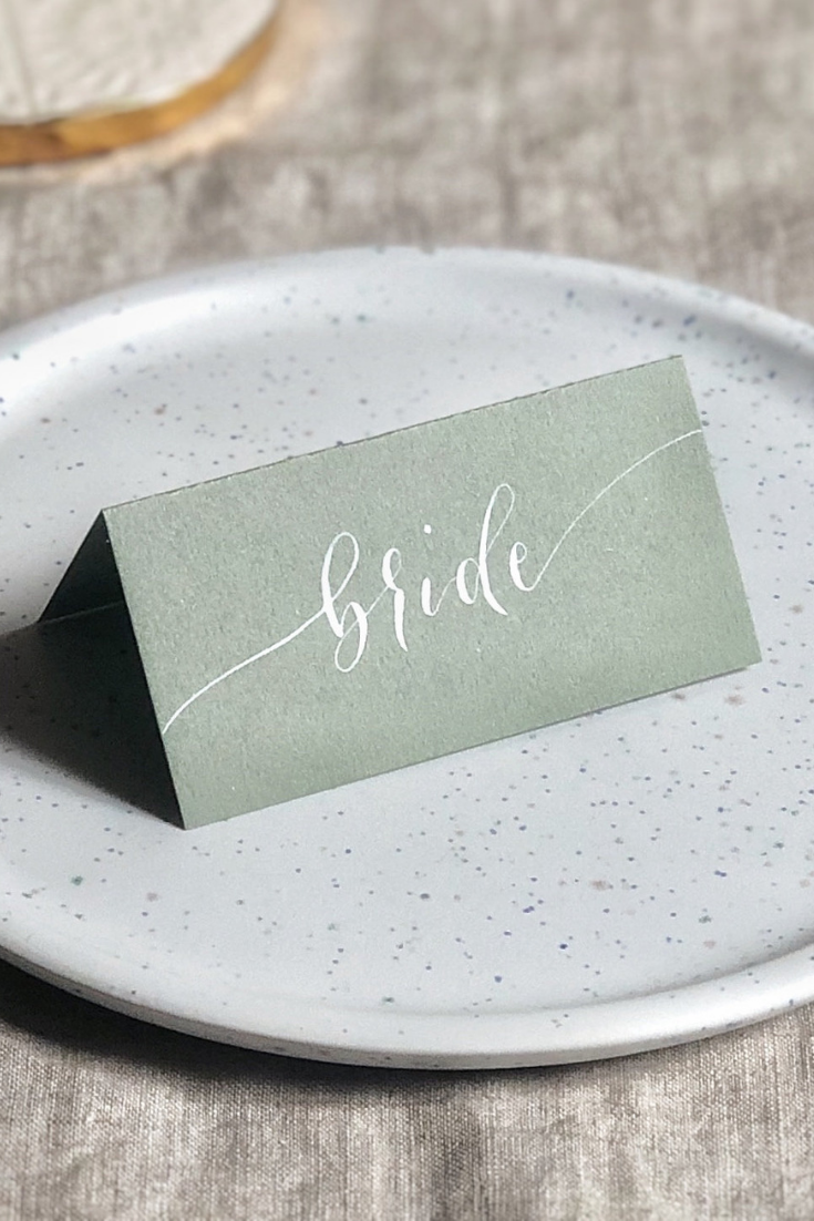 Sage green name cards, wedding stationery, place cards, table decor.png