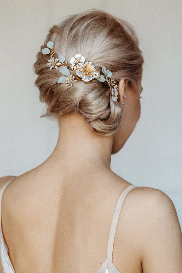 Bridal floral comb Wedding floral headpiece twisted updo bridal hairstyle.png