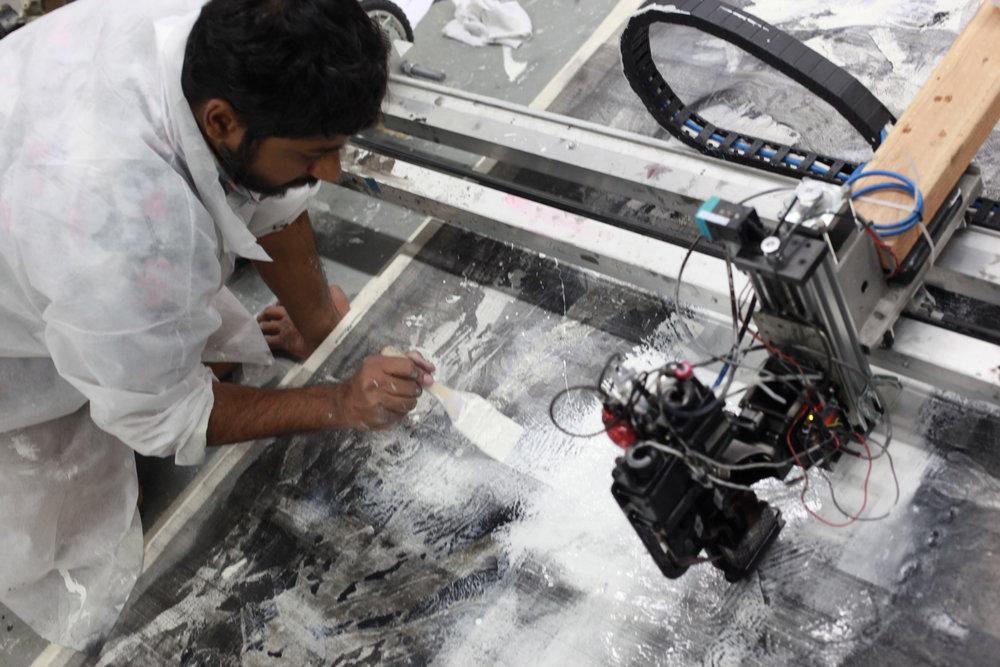 Raghava KK painting alongside Artmatr's oil-based ink printer