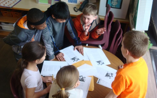 students-working-around-table-in-classroom.jpg